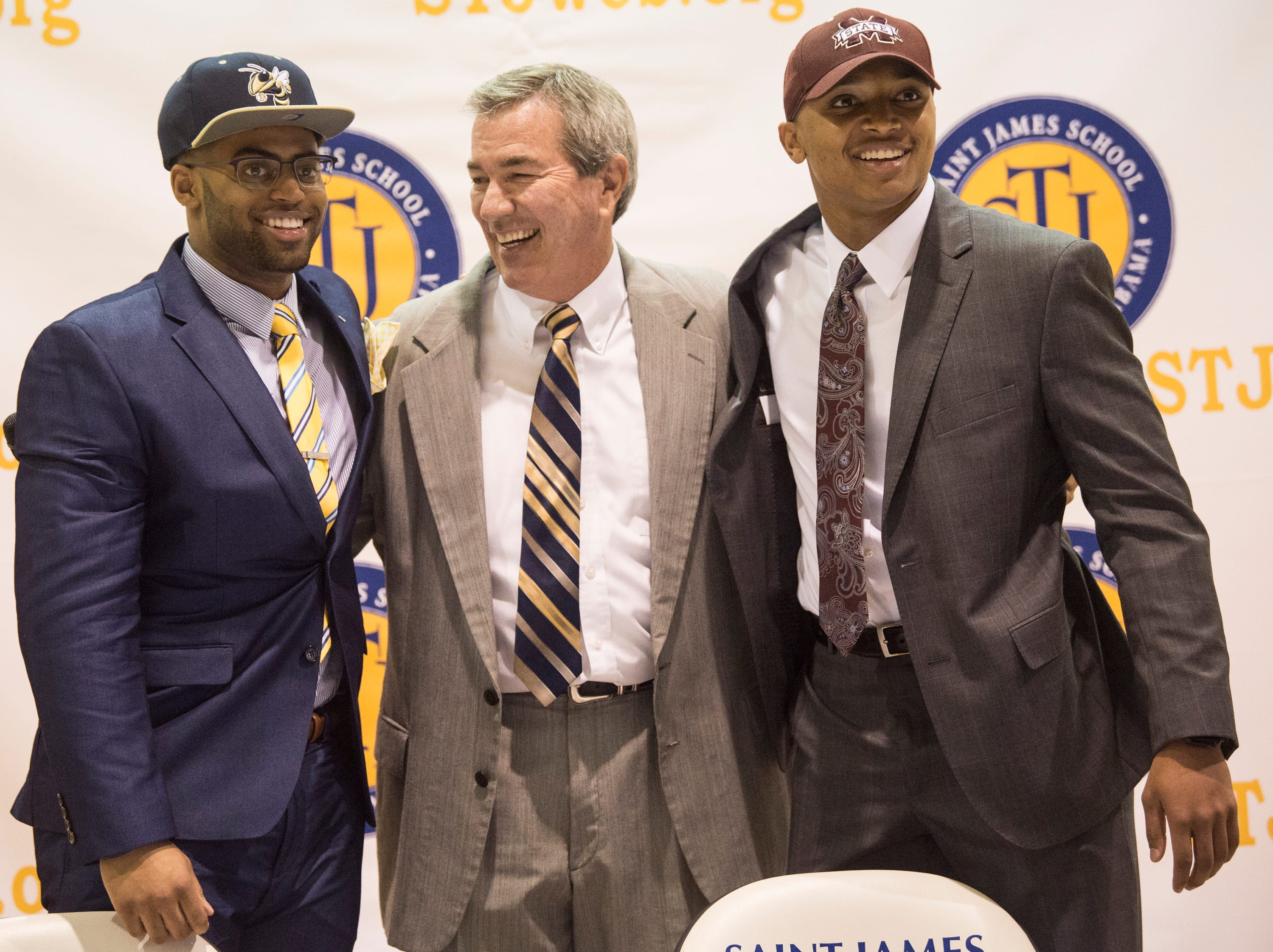 Tony Amerson, from left, coach Jimmy Perry and Collin Duncan during signing day at St. James High School in Montgomery, Ala., on Wednesday, Feb. 6, 2019.