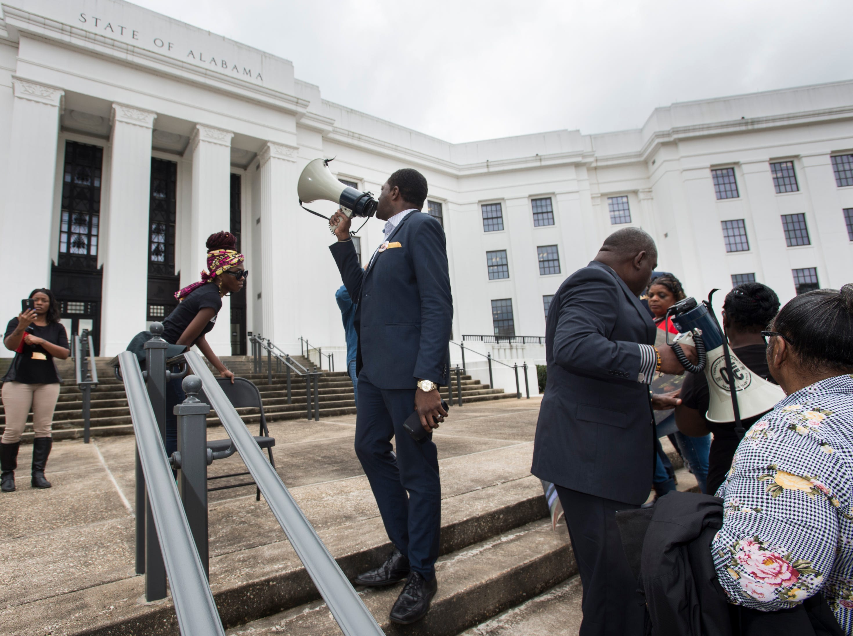 Protestors join EJ Bradford's family as they march around the Alabama Attorney General's office during a protest in Montgomery, Ala., on Wednesday, Feb. 6, 2019. EJ Bradford was shot and killed by police Nov. 22, 2018 in a Hoover, Ala. mall. Alabama Attorney General Steve Marshall announced Tuesday there would be no charges filed against the officer involved in the shooting.