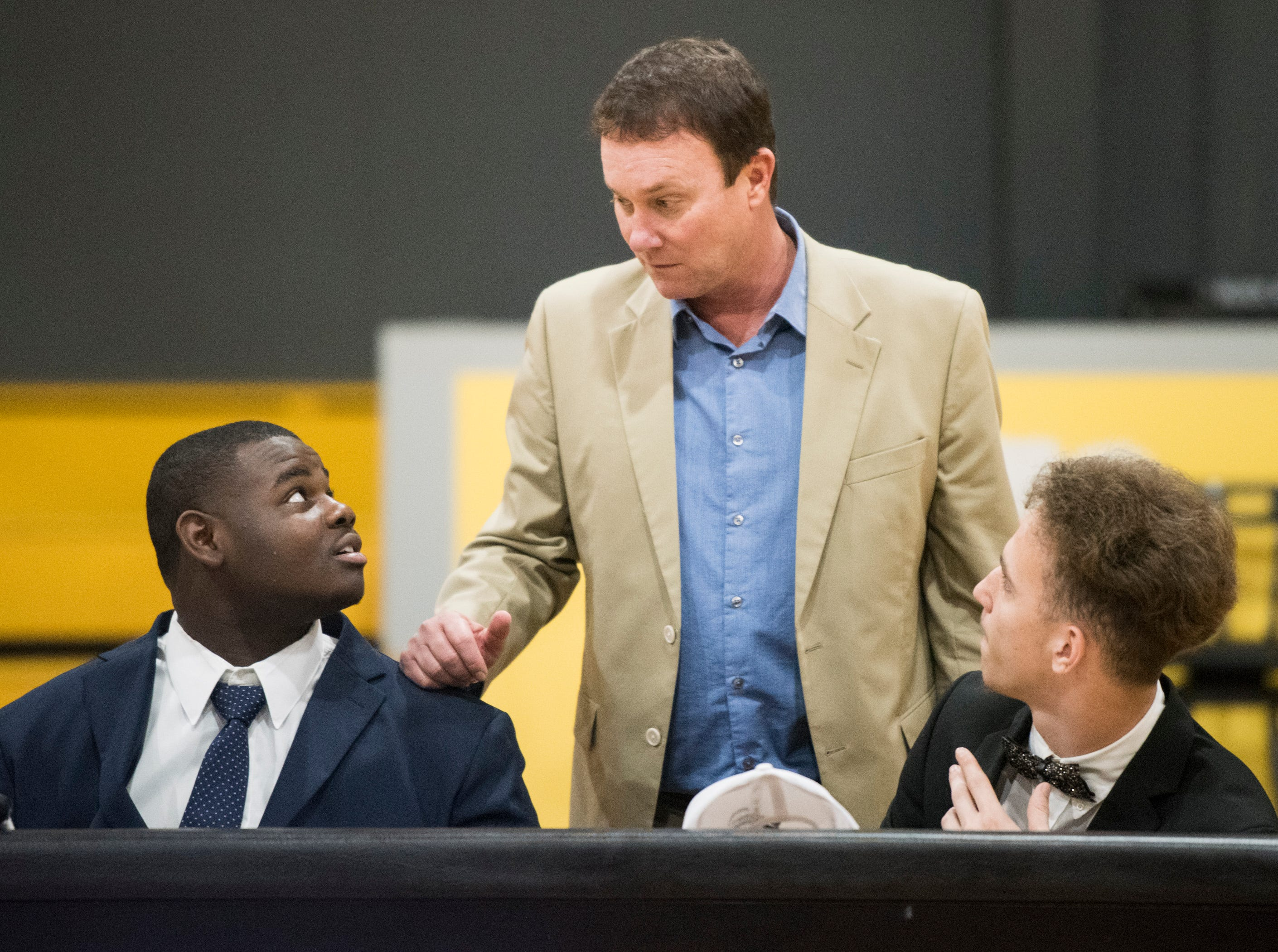 Coach Booby Carr talks with his players during signing day at Autauga Academy Prattville, Ala., on Wednesday, Feb. 6, 2019.
