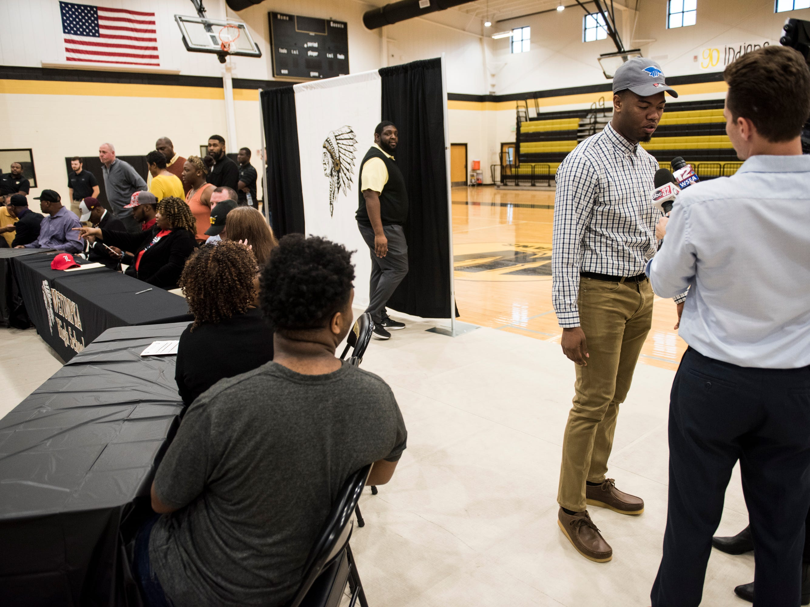 Darren Nolen is interviewed after announcing is signing with Hutchison Community College during signing day at Wetumpka High School in Wetumpka, Ala., on Wednesday, Feb. 6, 2019.