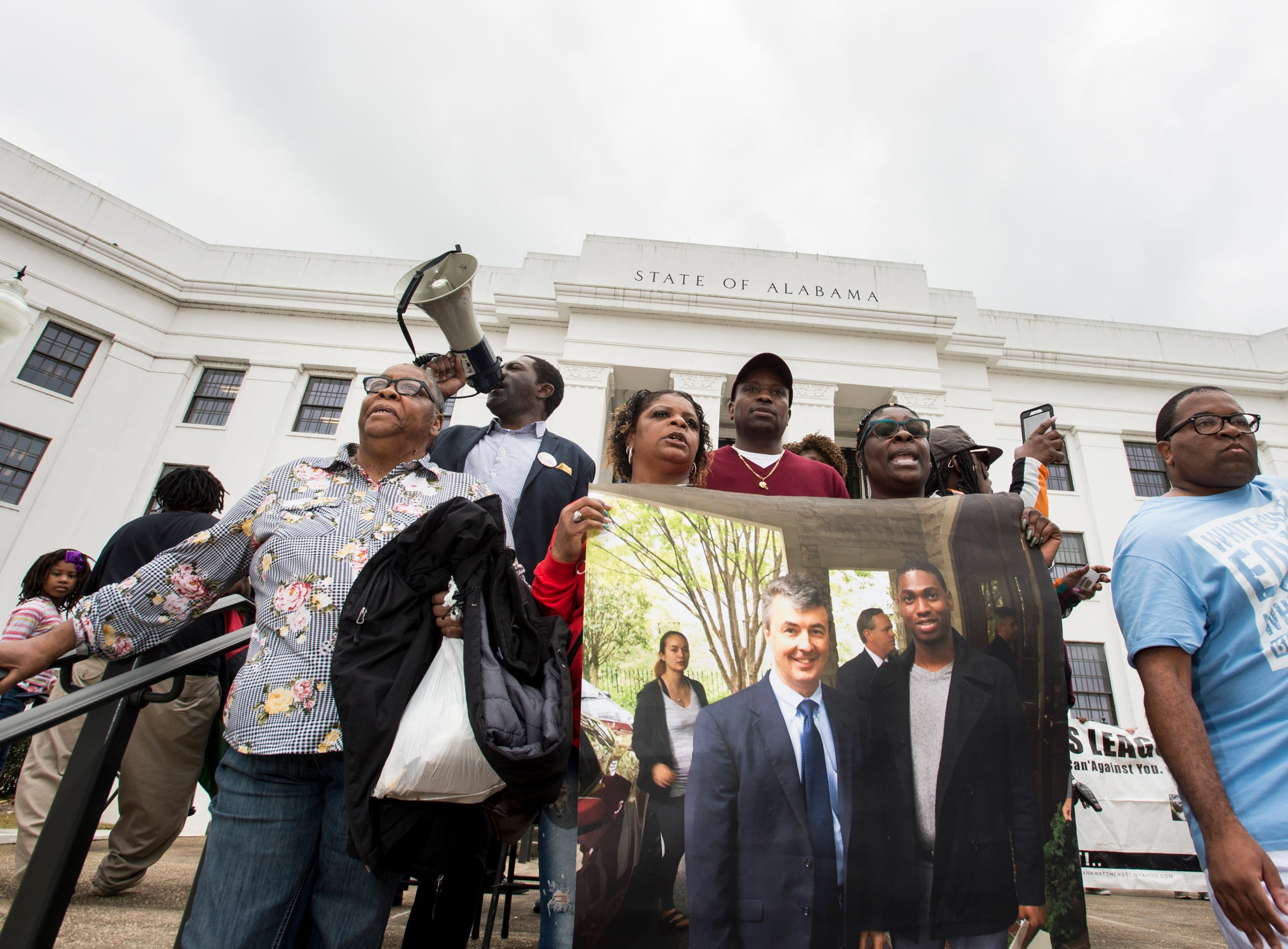EJ Bradford's family lines up on the steps of the Attorney General's office during a protest in Montgomery, Ala., on Wednesday, Feb. 6, 2019. EJ Bradford was shot and killed by police Nov. 22, 2018 in a Hoover, Ala. mall. Alabama Attorney General Steve Marshall announced Tuesday there would be no charges filed against the officer involved in the shooting.