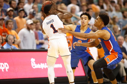 Auburn guard Jared Harper (1) is surrounded by Florida guards Andrew Nembhard (2) and Noah Locke (10) during the first half at Auburn Arena on Feb. 5, 2019.