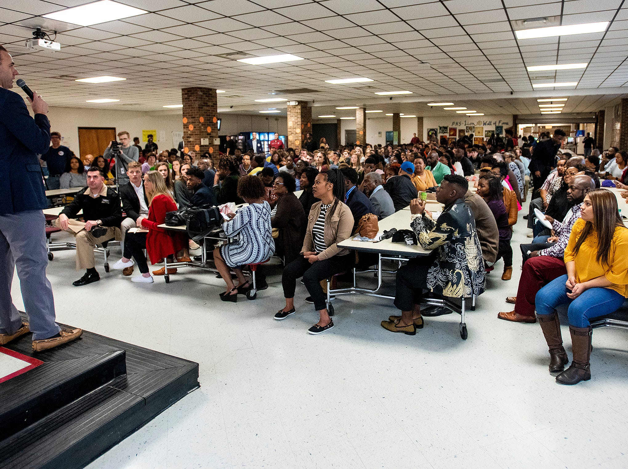 Prattville Head Football Coach Caleb Ross speaks to those attending college football signing day at the school's campus in Pratttville, Ala., on Wednesday February 6, 2019.
