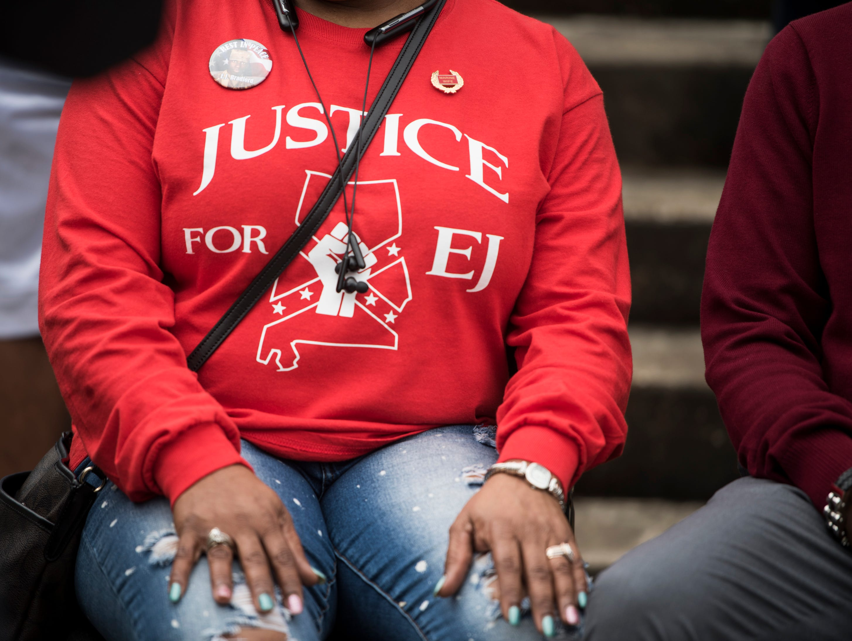 "Cynthia Bradford wears a ""Justice for EJ"" shirt during a protest for her stepson in Montgomery, Ala., on Wednesday, Feb. 6, 2019. EJ Bradford was shot and killed by police Nov. 22, 2018 in a Hoover, Ala. mall. Alabama Attorney General Steve Marshall announced Tuesday there would be no charges filed against the officer involved in the shooting."