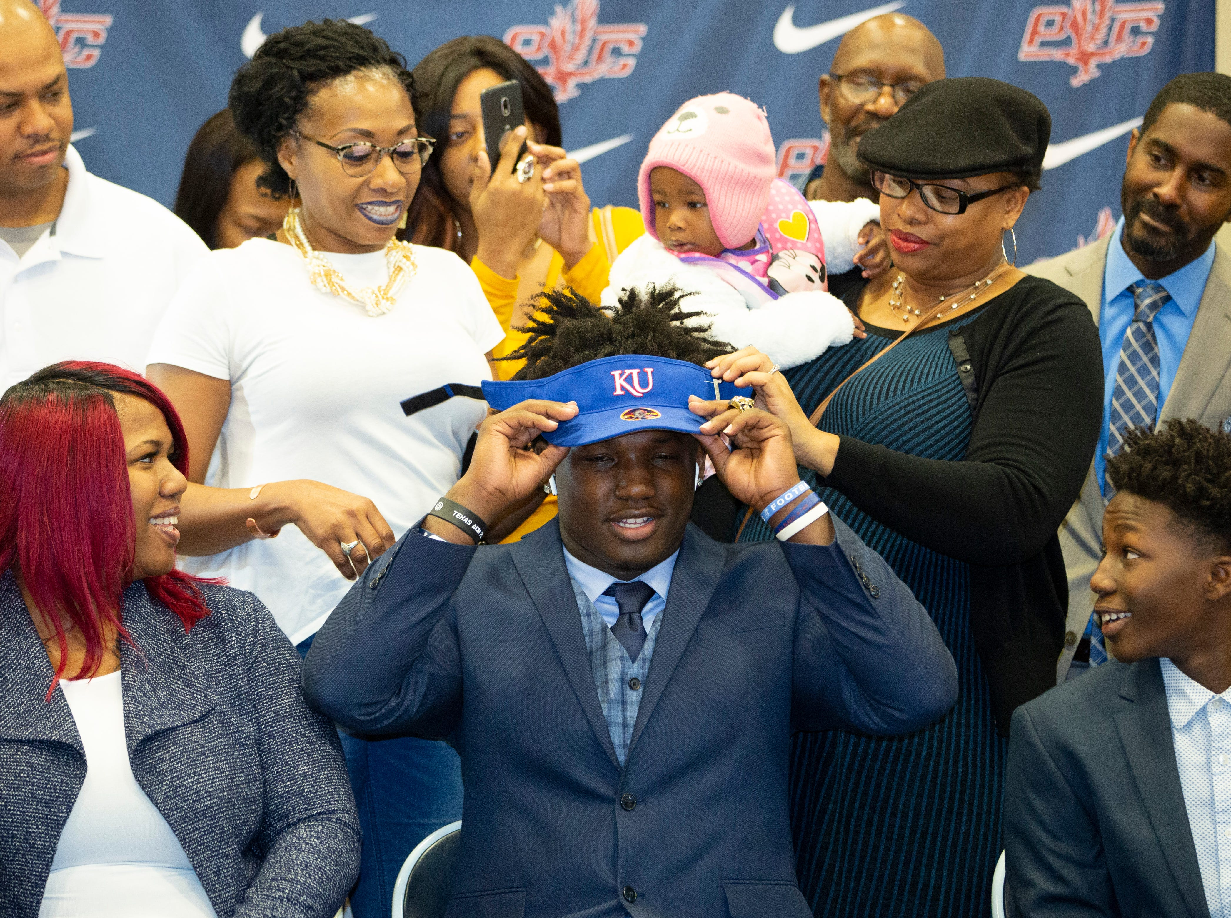 Marcus Harris, a football player at Park Crossing, signed with Kansas.