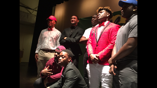 "Carver's 2019 signing class ""smiles"" for the cameras Wednesday."