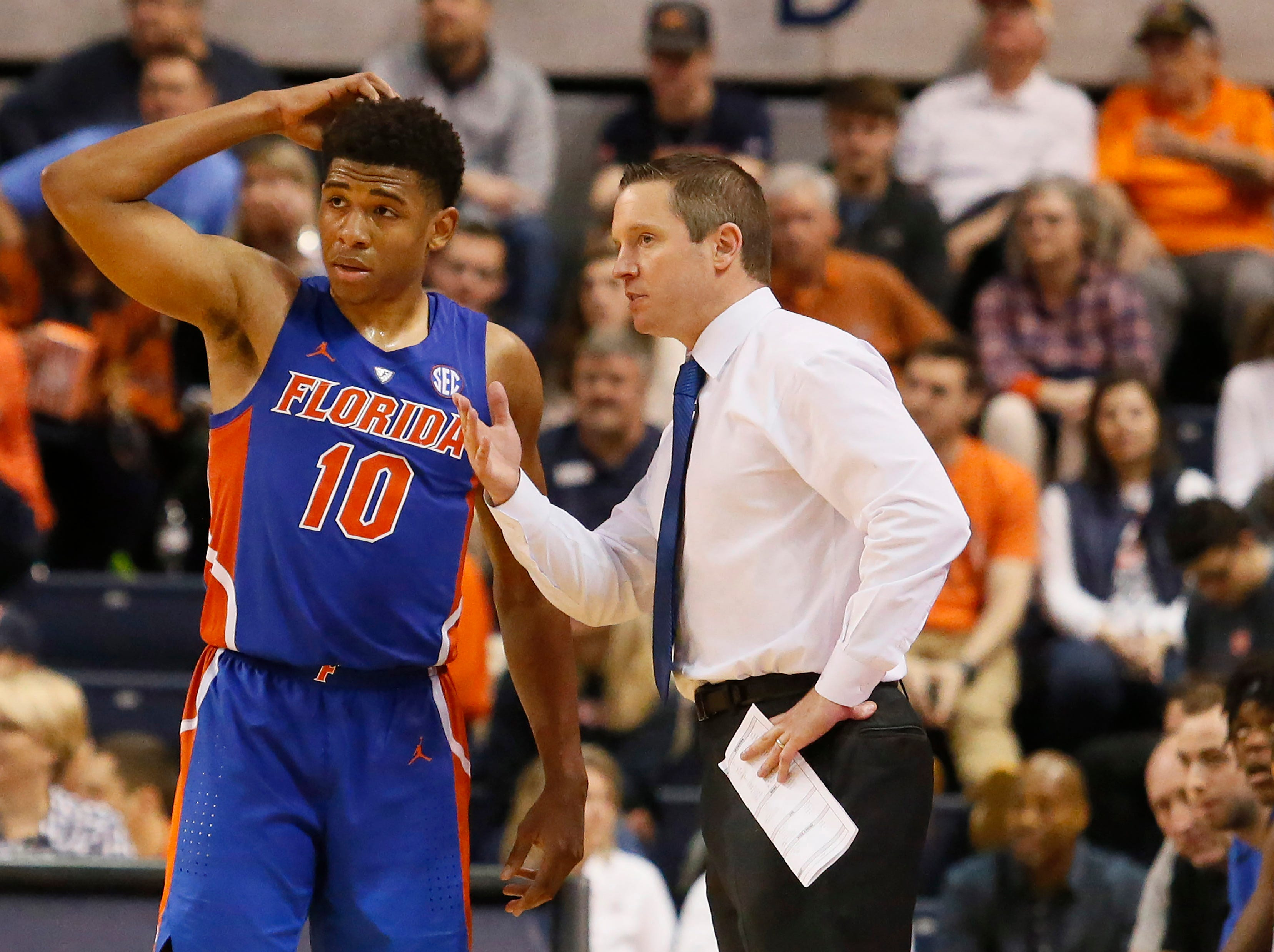 Feb 5, 2019; Auburn, AL, USA; Florida Gators guard Noah Locke (10) speaks with head coach Mike White during the second half against the Auburn Tigers at Auburn Arena. Mandatory Credit: John Reed-USA TODAY Sports