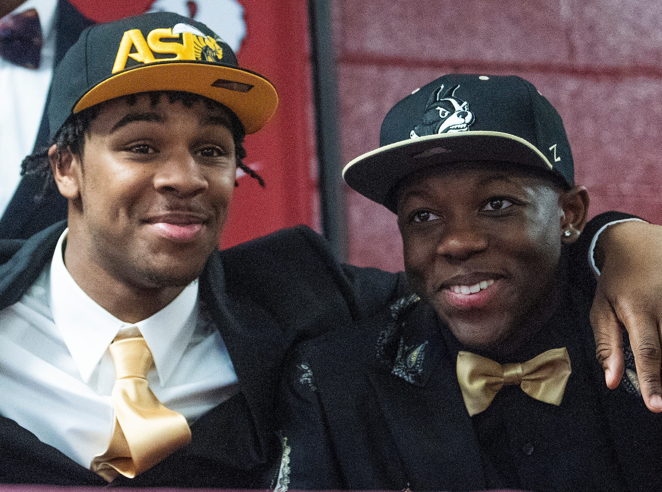 Prattville's Jake Howard, left, and Jacquez Allen during college football signing day at the school's campus in Pratttville, Ala., on Wednesday February 6, 2019.