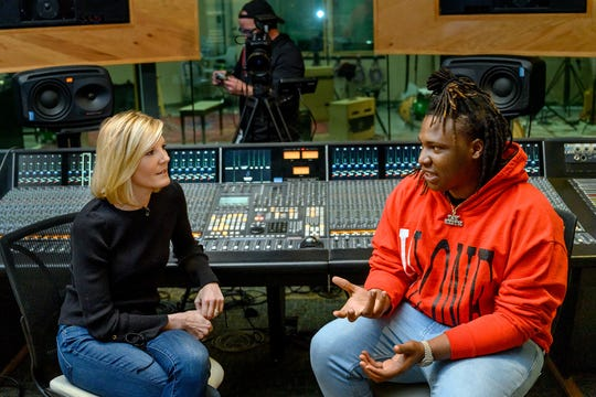 """Journalist Kate Snow, anchor of NBC Nightly News Sunday and senior national correspondent, interviews MTSU alumnus and rising music producer BryTavious """"Tay Keith"""" Chambers inside a recording studio at the Bragg Media and Entertainment Building in late January. The segment about MTSU's Department of Recording Industry, its successful alumni and annual Grammy Awards outreach will air Sunday, Feb. 10, before the Grammys telecast on CBS."""