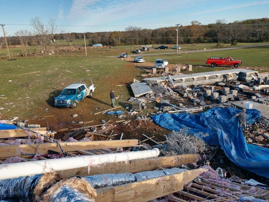 The debris field of the home at 7812 Midland Road in Christiana, Tennessee, owned by Angie and Scott Walker. A tornado lifted the house and threw it 100 feet from its foundation, killing Angie Walker and injuring daughter Olivia Walker.