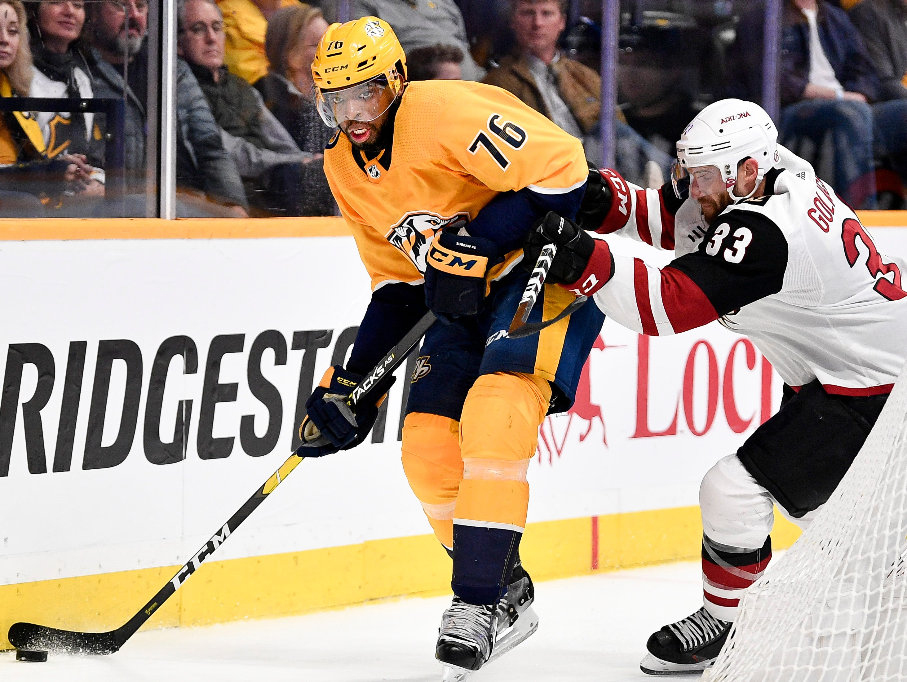 Nashville Predators defenseman P.K. Subban (76) battles for the puck with Arizona Coyotes defenseman Alex Goligoski (33) during the first period at Bridgestone Arena in Nashville, Tenn., Tuesday, Feb. 5, 2019.