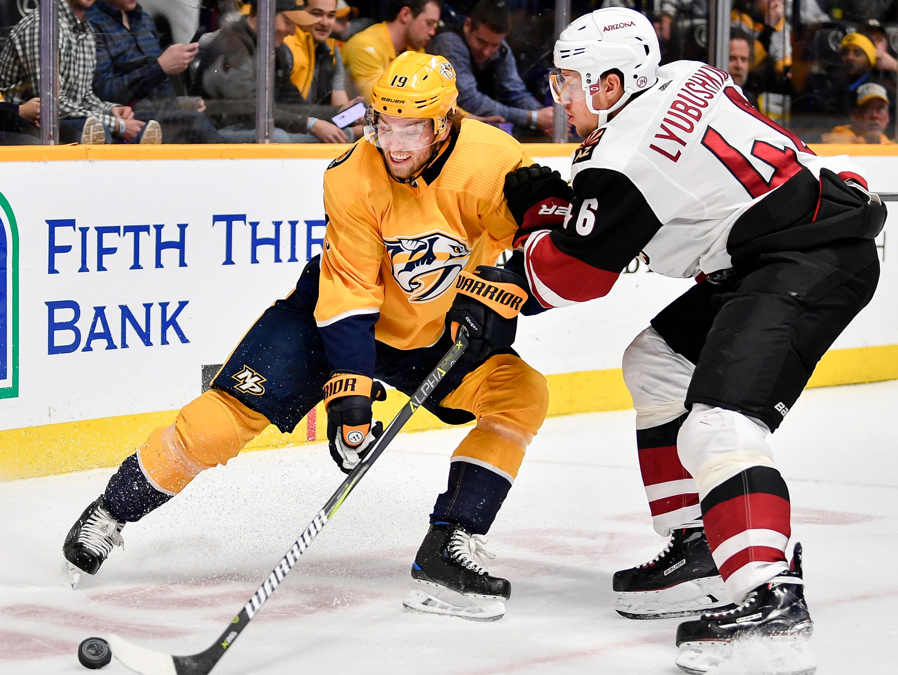 Nashville Predators center Calle Jarnkrok (19) fights for the puck with Arizona Coyotes defenseman Ilya Lyubushkin (46) during the first period at Bridgestone Arena in Nashville, Tenn., Tuesday, Feb. 5, 2019.