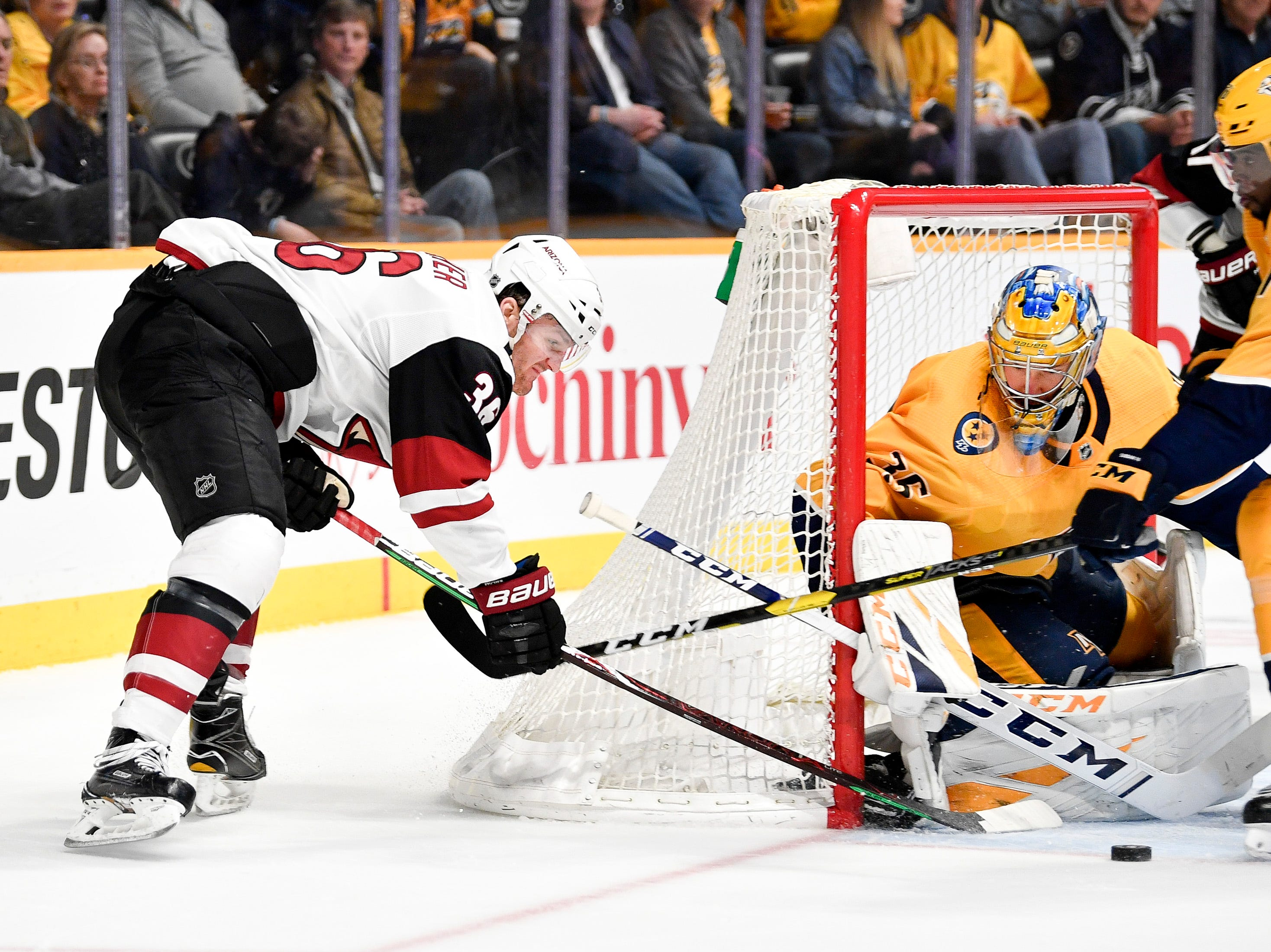 Arizona Coyotes right wing Christian Fischer (36) shoots into Nashville Predators goaltender Pekka Rinne (35) and defenseman P.K. Subban (76) during the second period at Bridgestone Arena in Nashville, Tenn., Tuesday, Feb. 5, 2019.