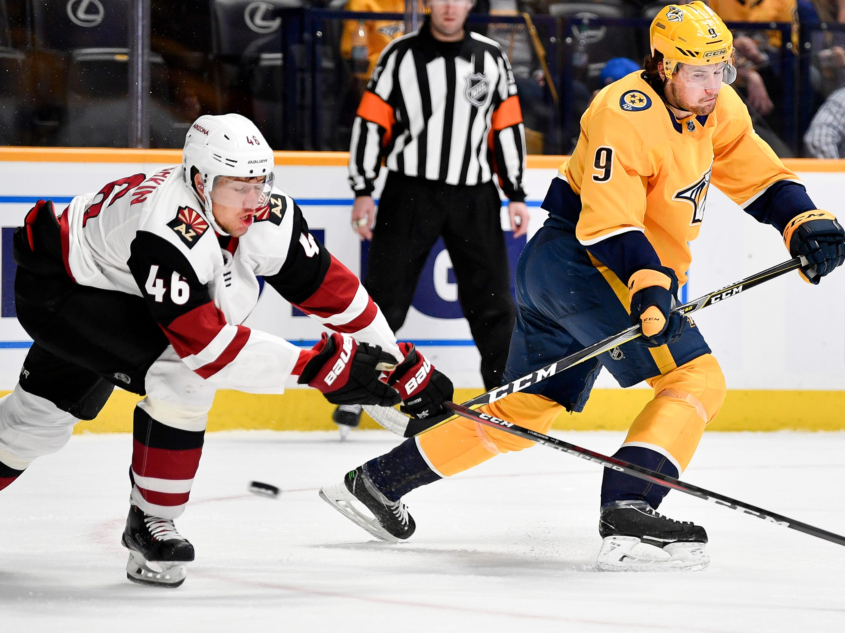Nashville Predators left wing Filip Forsberg (9) shoots past Arizona Coyotes defenseman Ilya Lyubushkin (46) during the first period at Bridgestone Arena in Nashville, Tenn., Tuesday, Feb. 5, 2019.