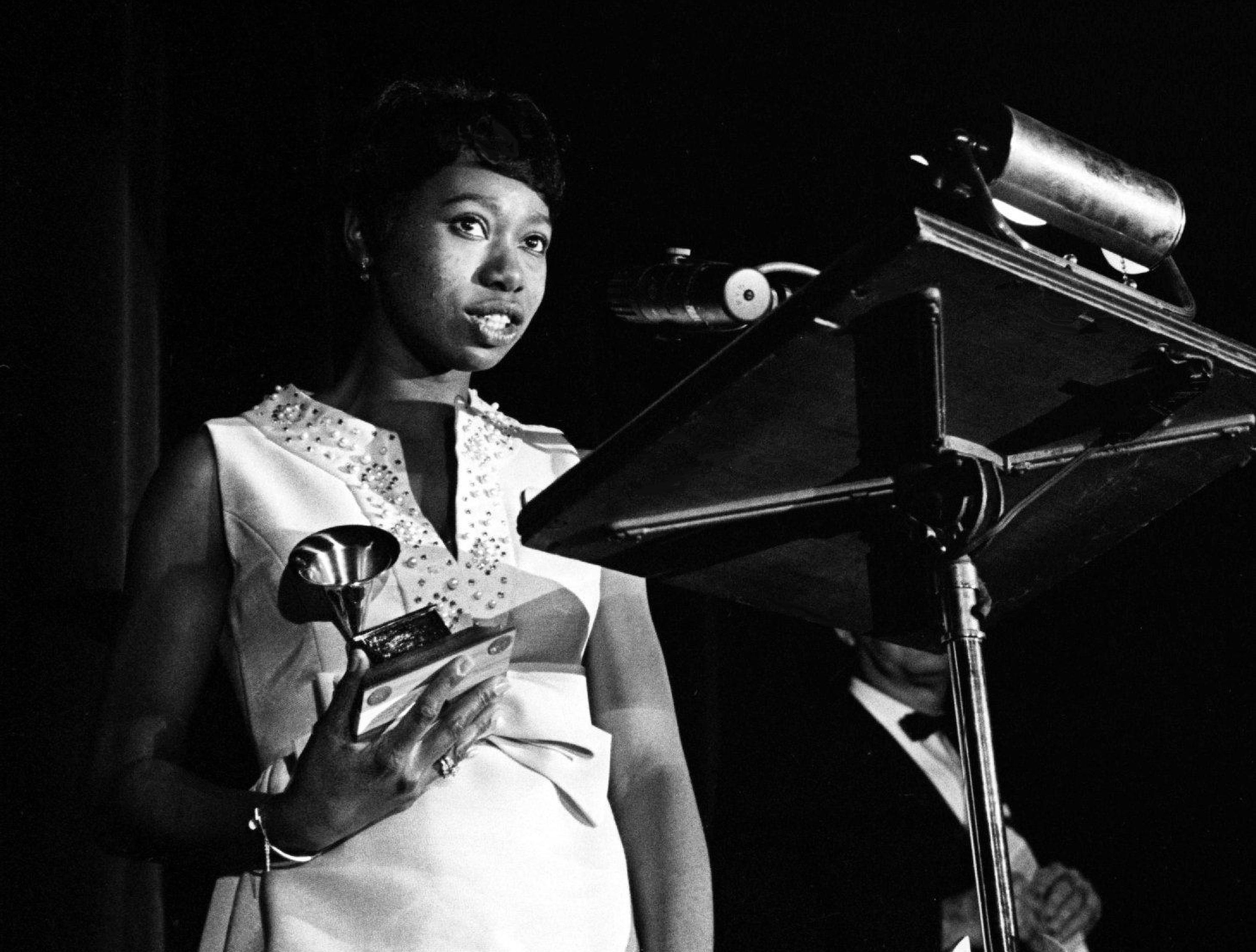 "Zelma Redding is accepting one of two awards for her late husband, Otis Redding, during the 11th annual Grammy Award show at the National Guard Armory in Nashville March 12, 1969. The singer, who was killed in a plane crash last year, won the Best Rhythm and Blues Male Performance and Best Rhythm and Blue Song awards for ""Dock Of The Bay."""