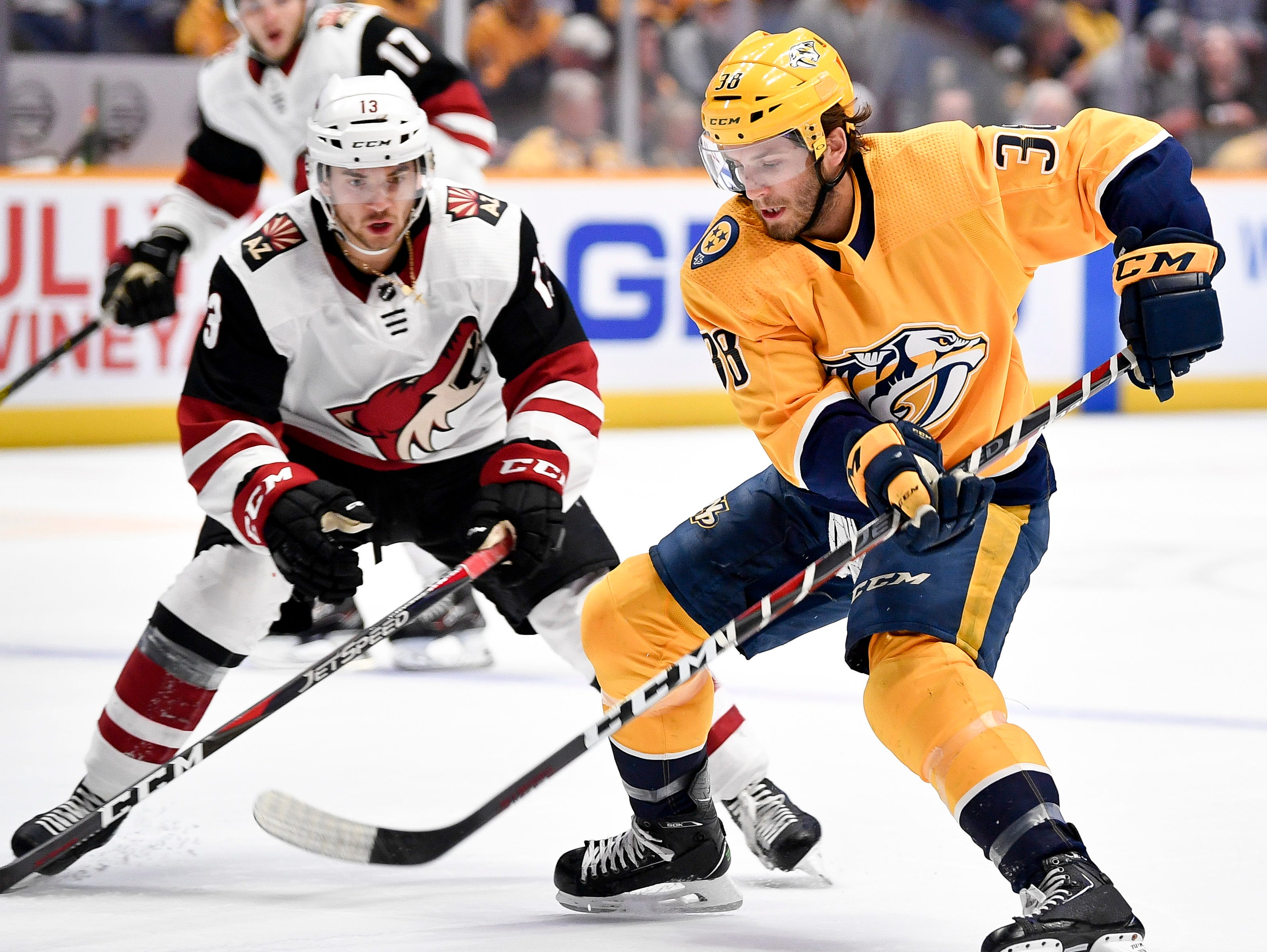 Nashville Predators right wing Ryan Hartman (38) battles Arizona Coyotes center Vinnie Hinostroza (13) during the first period at Bridgestone Arena in Nashville, Tenn., Tuesday, Feb. 5, 2019.