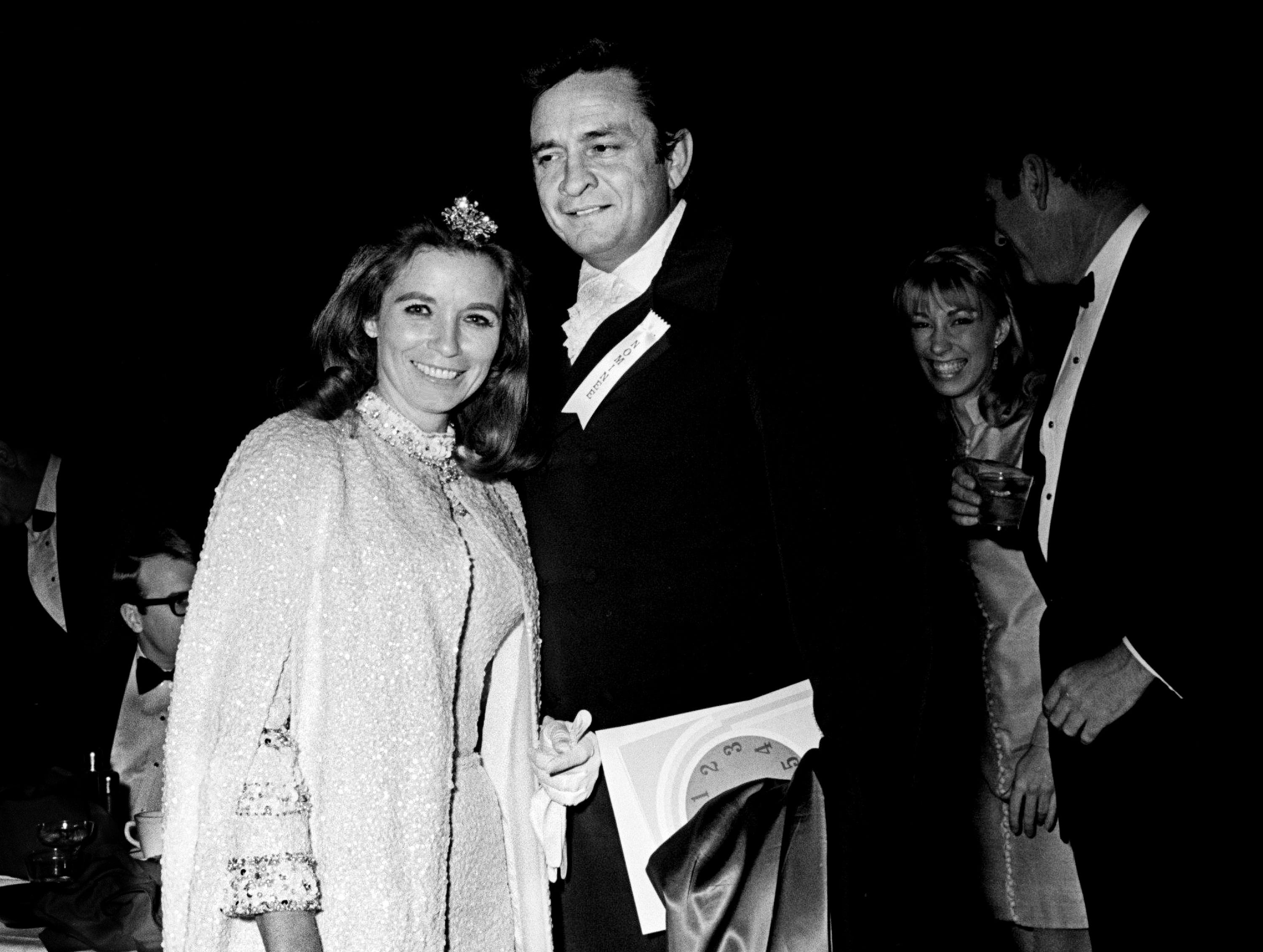 Country music star Johnny Cash and June Carter Cash arrive for the 11th annual Grammy Award show at the National Guard Armory in Nashville March 12, 1969. The awards were presented simultaneously at banquets in New York, Chicago, Los Angeles and Nashville.