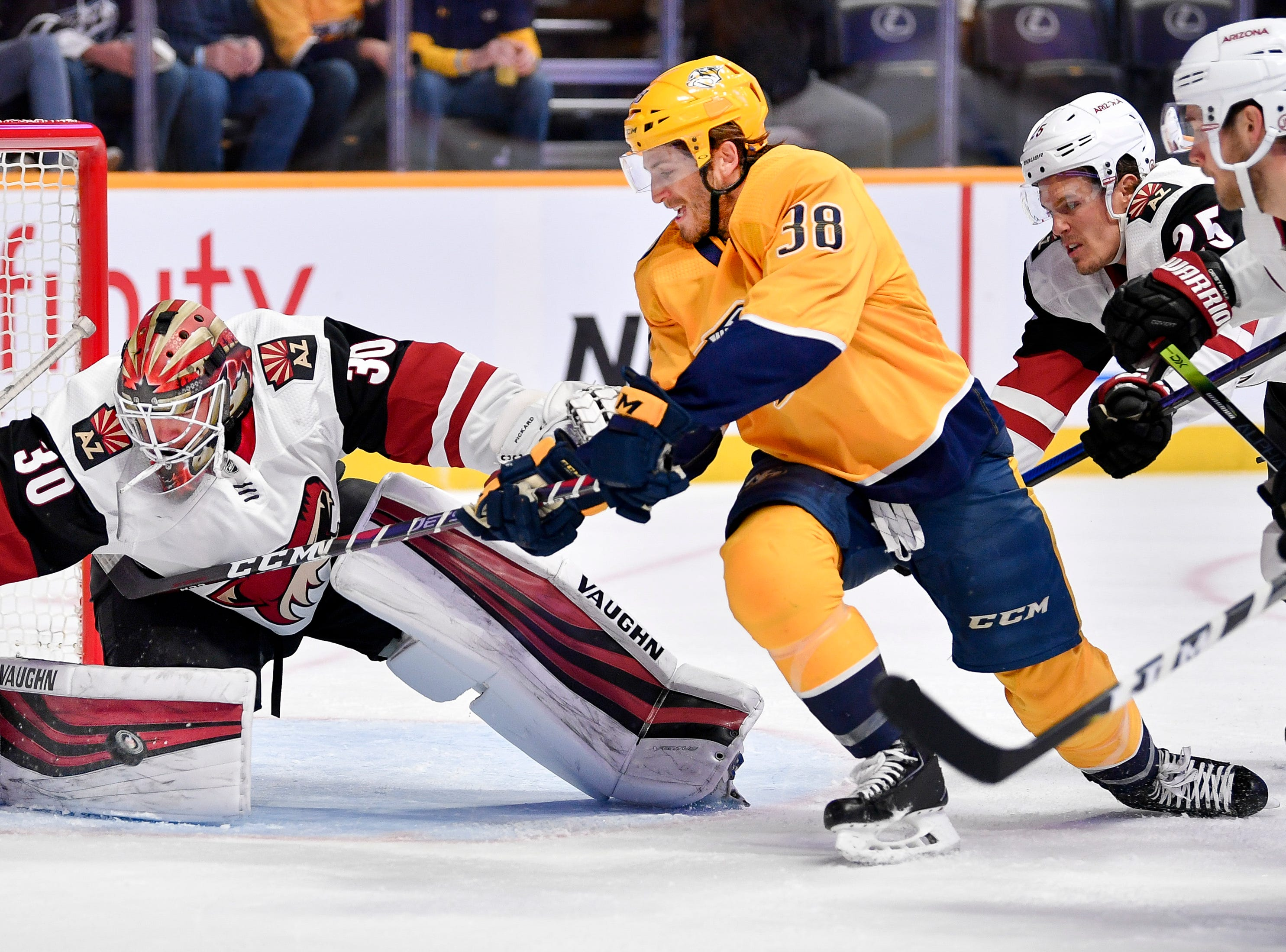 Arizona Coyotes goaltender Calvin Pickard (30) blocks a shot from Nashville Predators right wing Ryan Hartman (38) during the first period at Bridgestone Arena in Nashville, Tenn., Tuesday, Feb. 5, 2019.