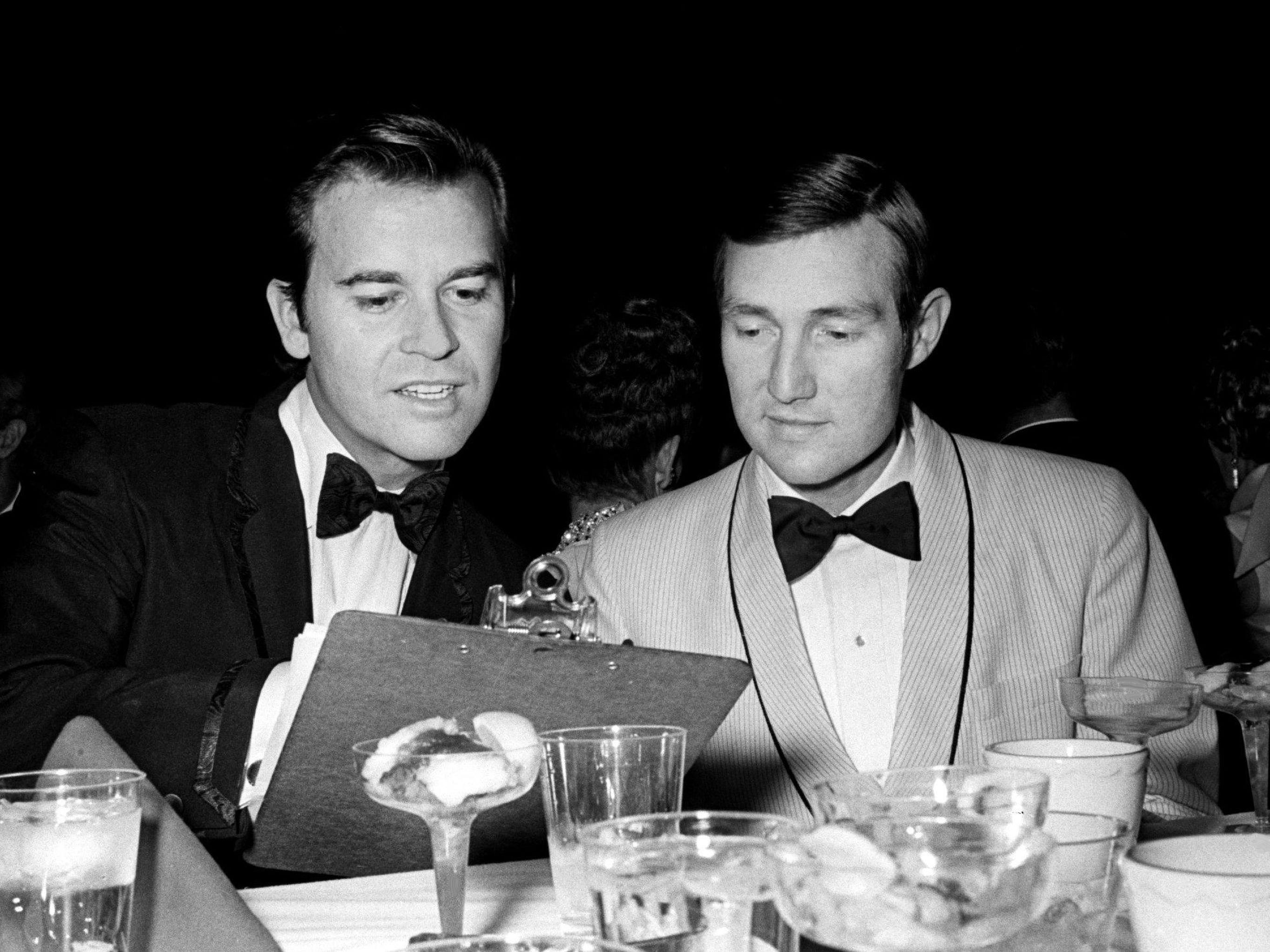 Dick Clark, left, master of ceremonies, and Don Light, president of Nashville chapter of NARAS, goes over the program together before the Grammy ceremonies got under way at the National Guard Armory in Nashville March 12, 1969.