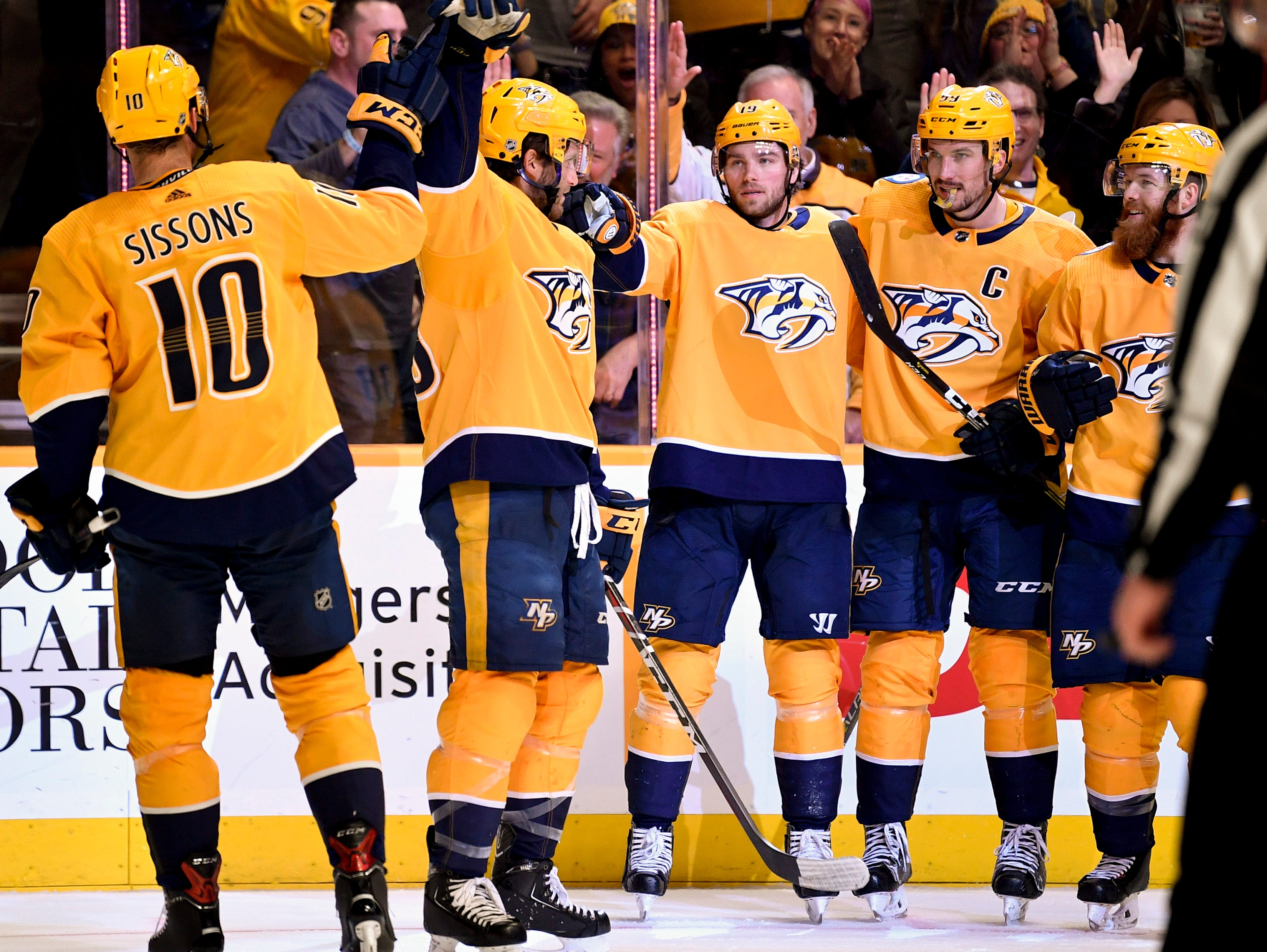 Feb. 5, 2019: Preds 5, Arizona 2 - Nashville Predators center Calle Jarnkrok (19, center) celebrates with teammates after scoring against the Arizona Coyotes during the third period at Bridgestone Arena in Nashville, Tenn., Tuesday, Feb. 5, 2019.