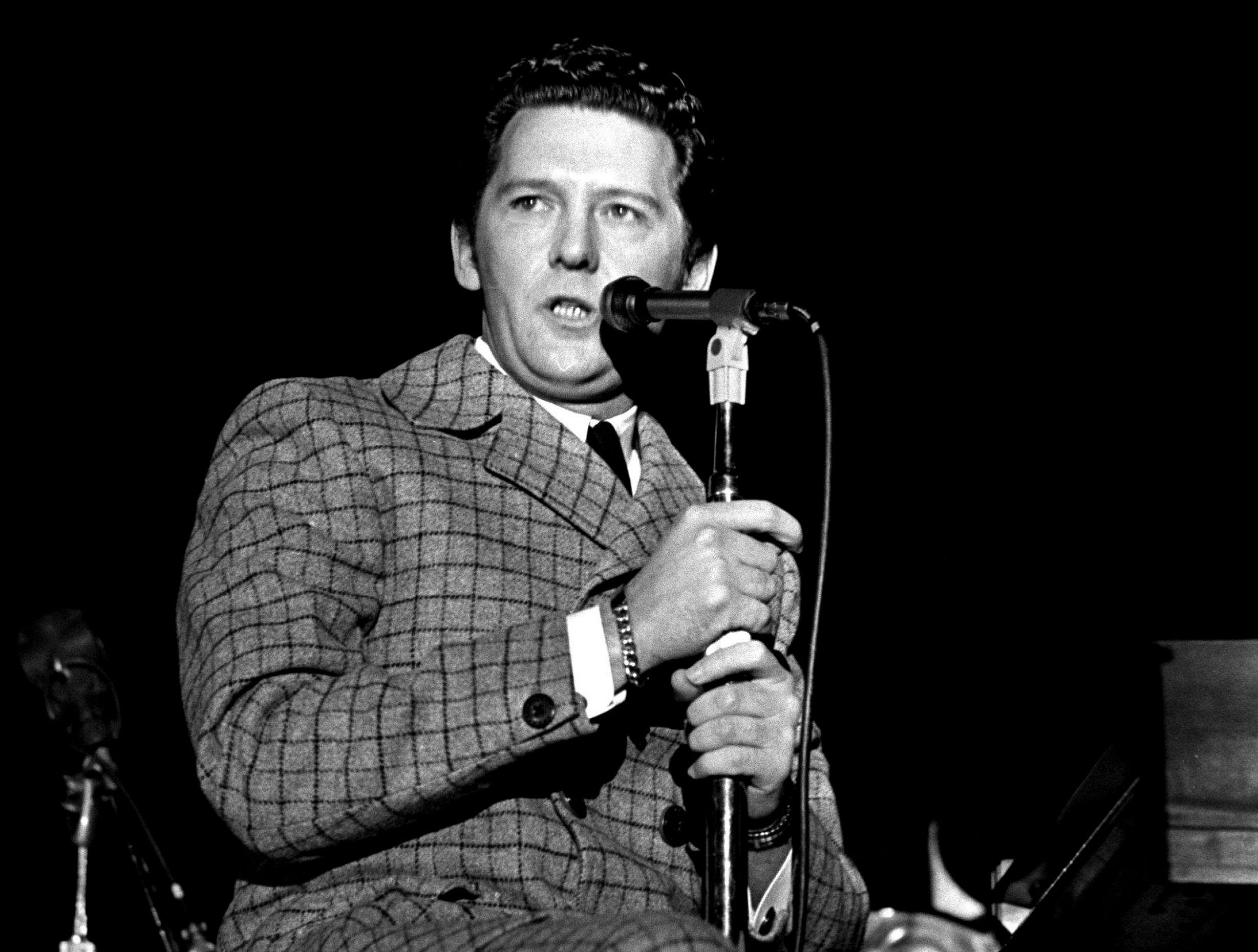 Jerry Lee Lewis is performing for the crowd of 950 during the NARAS annual gala awards celebration for the Grammy at the National Guard Armory March 12, 1969.