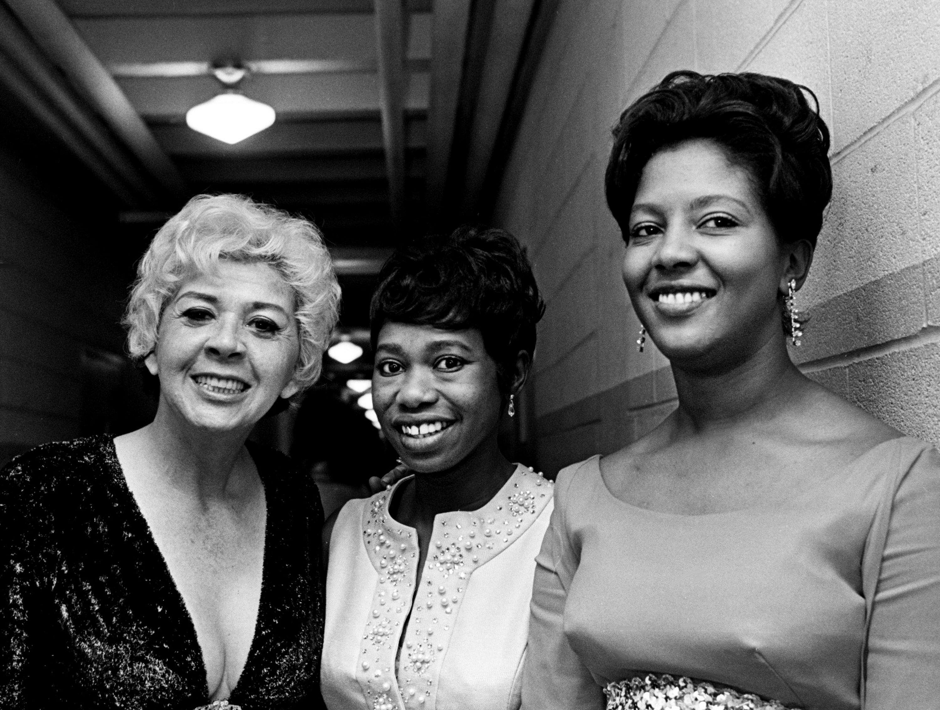 Zelma Redding, center, the widow of the late Otis Redding, shares a moment with a couple of other guests backstage toward the end of the 11th annual Grammy Award show at the National Guard Armory in Nashville March 12, 1969.