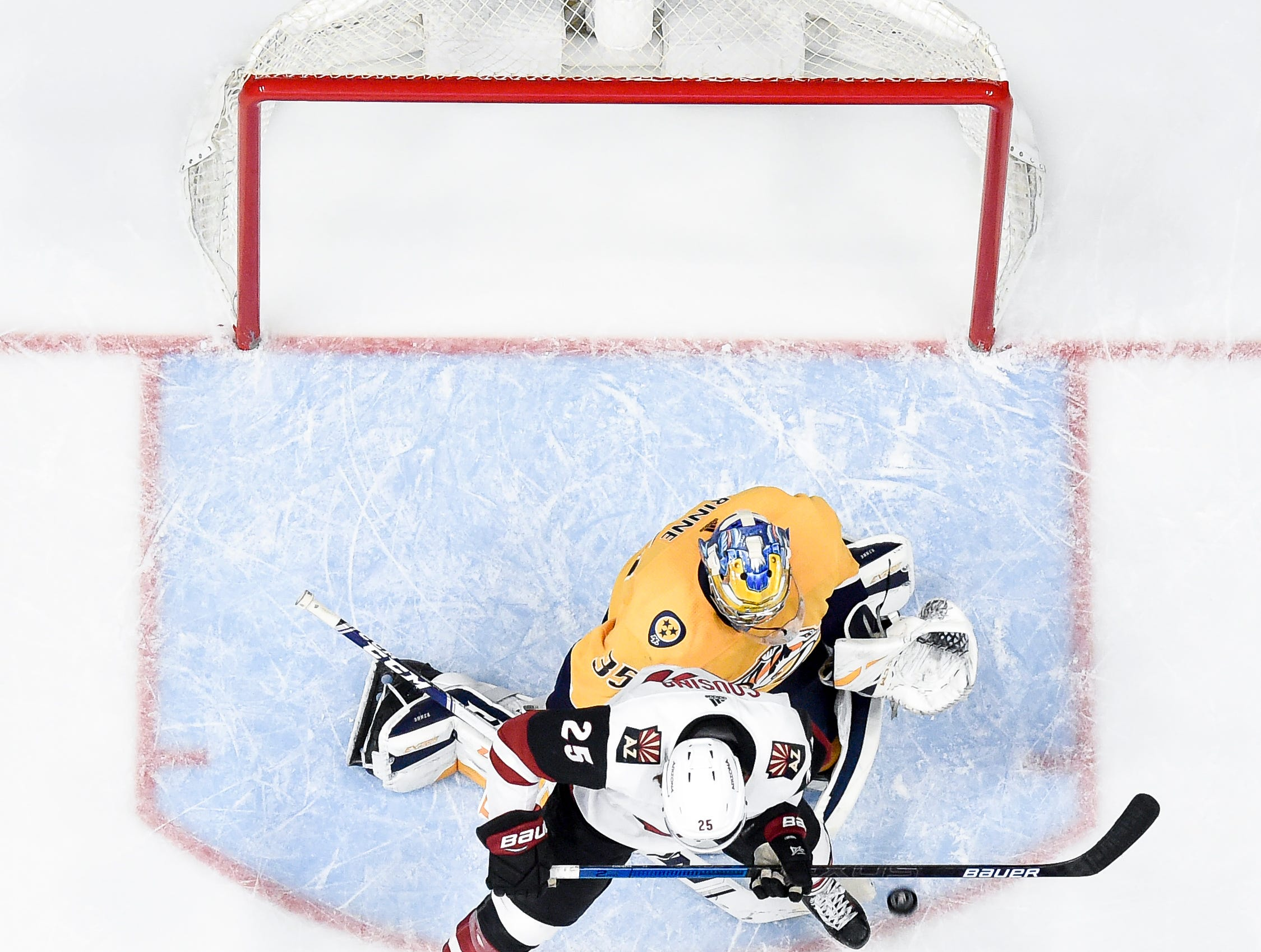 Nashville Predators goaltender Pekka Rinne (35) defends against Arizona Coyotes center Nick Cousins (25) during the third period at Bridgestone Arena in Nashville, Tenn., Tuesday, Feb. 5, 2019.