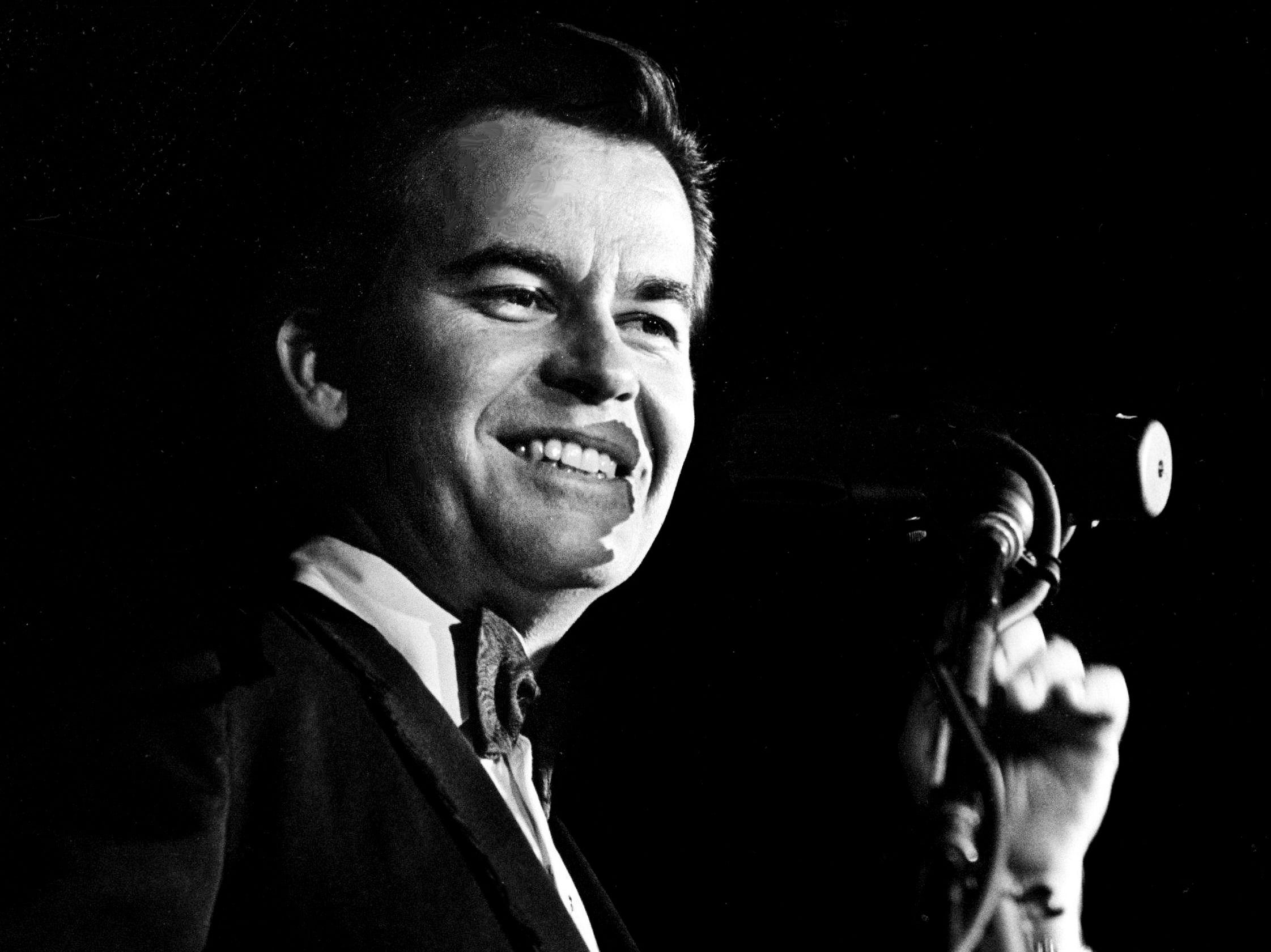 Dick Clark, master of ceremonies, gets ready to kick off the 11th annual Grammy Awards show at the National Guard Armory in Nashville March 12, 1969. The awards were presented simultaneously at banquets in New York, Chicago, Los Angeles and Nashville.