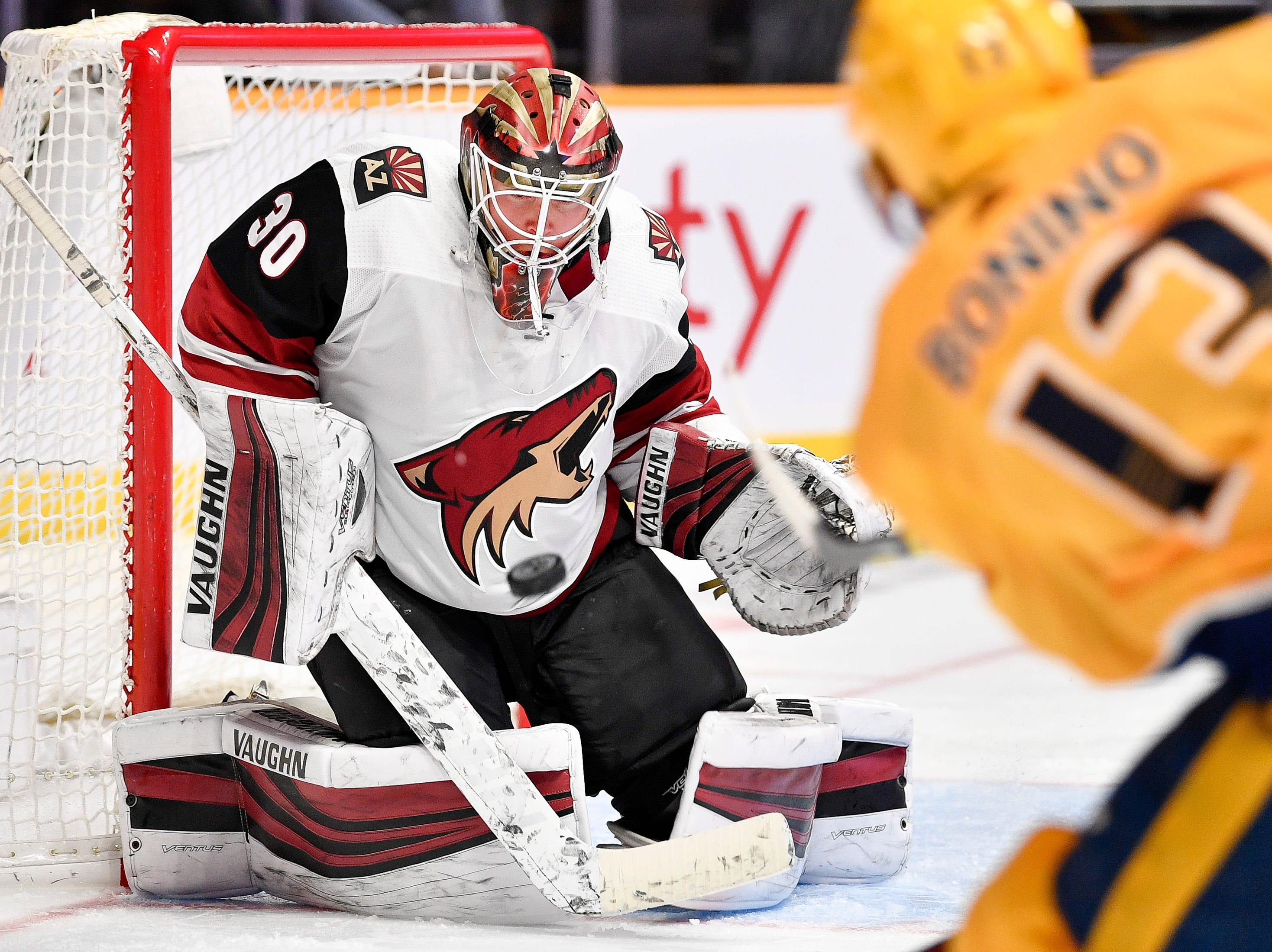 Nashville Predators center Nick Bonino (13) shoots into Arizona Coyotes goaltender Calvin Pickard (30) during the third period at Bridgestone Arena in Nashville, Tenn., Tuesday, Feb. 5, 2019.