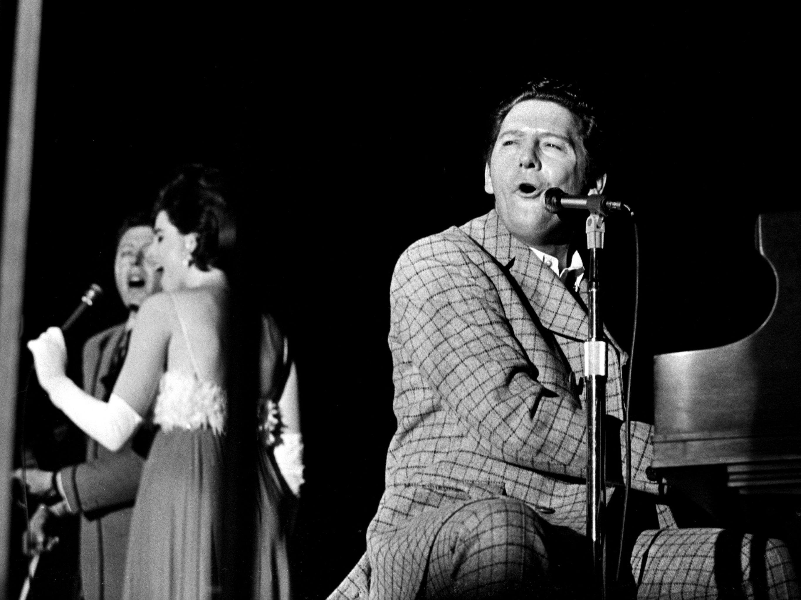 Jerry Lee Lewis, right, and his band is performing for the crowd of 950 during the NARAS annual gala awards celebration for the Grammy at the National Guard Armory March 12, 1969.