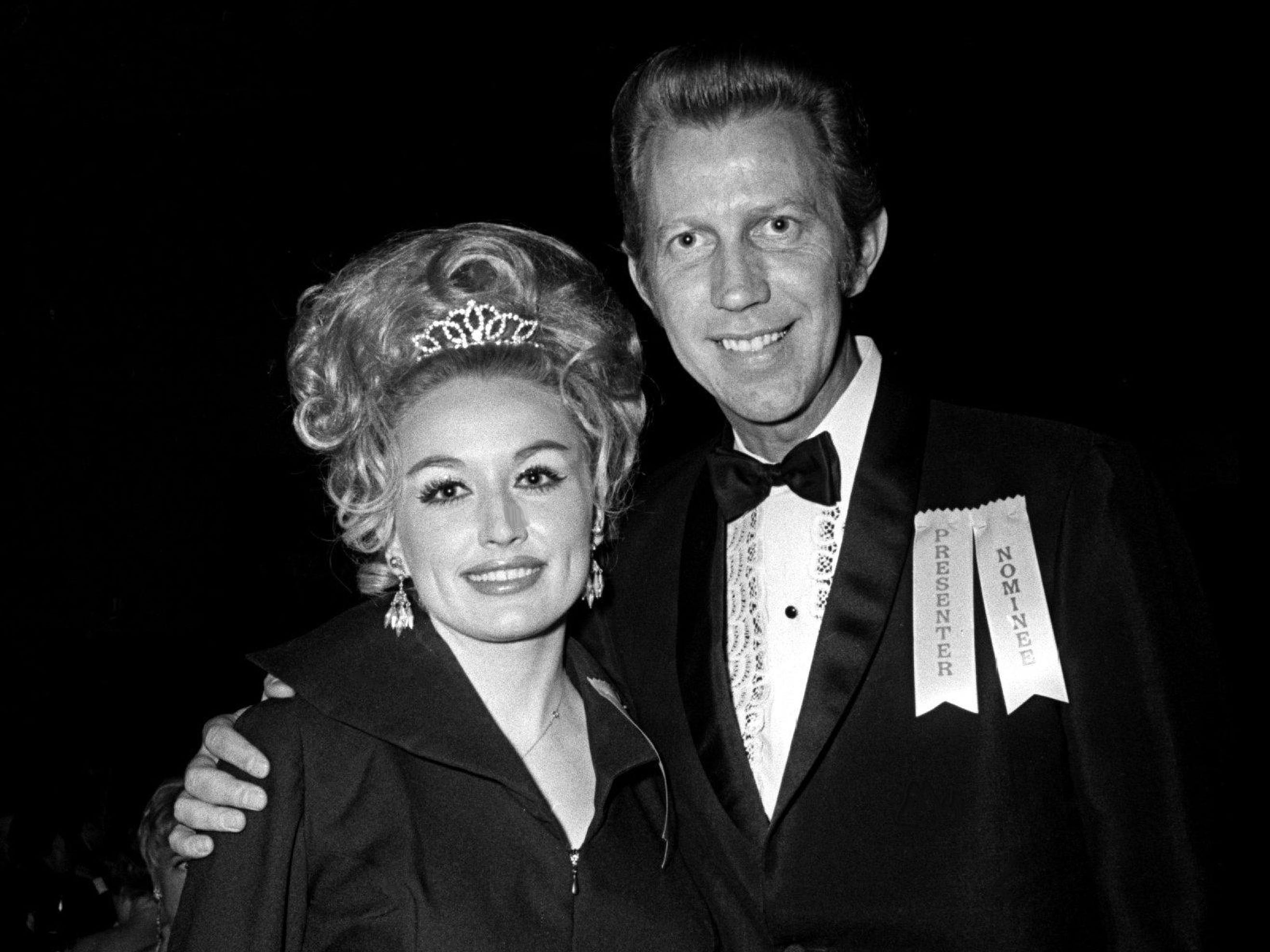 Presenters Dolly Parton, left, and Porter Wagoner, also a nominee, arrive for the Grammy Award show at the National Guard Armory in Nashville March 12, 1969.