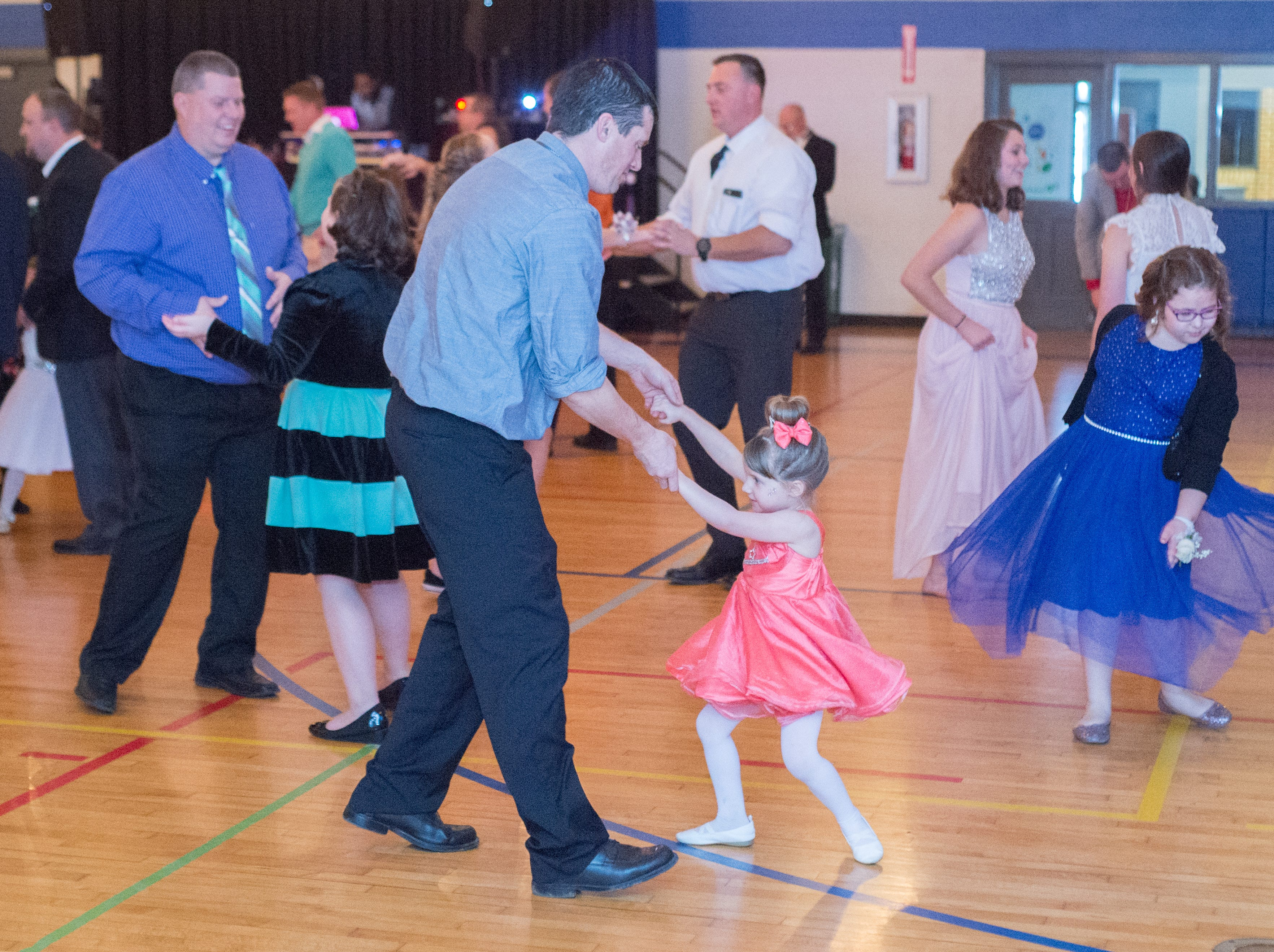 Attendees dance the night away during a Daddy Daughter Dance held at Delmas Long Community Center on Saturday, Feb. 2, 2019.