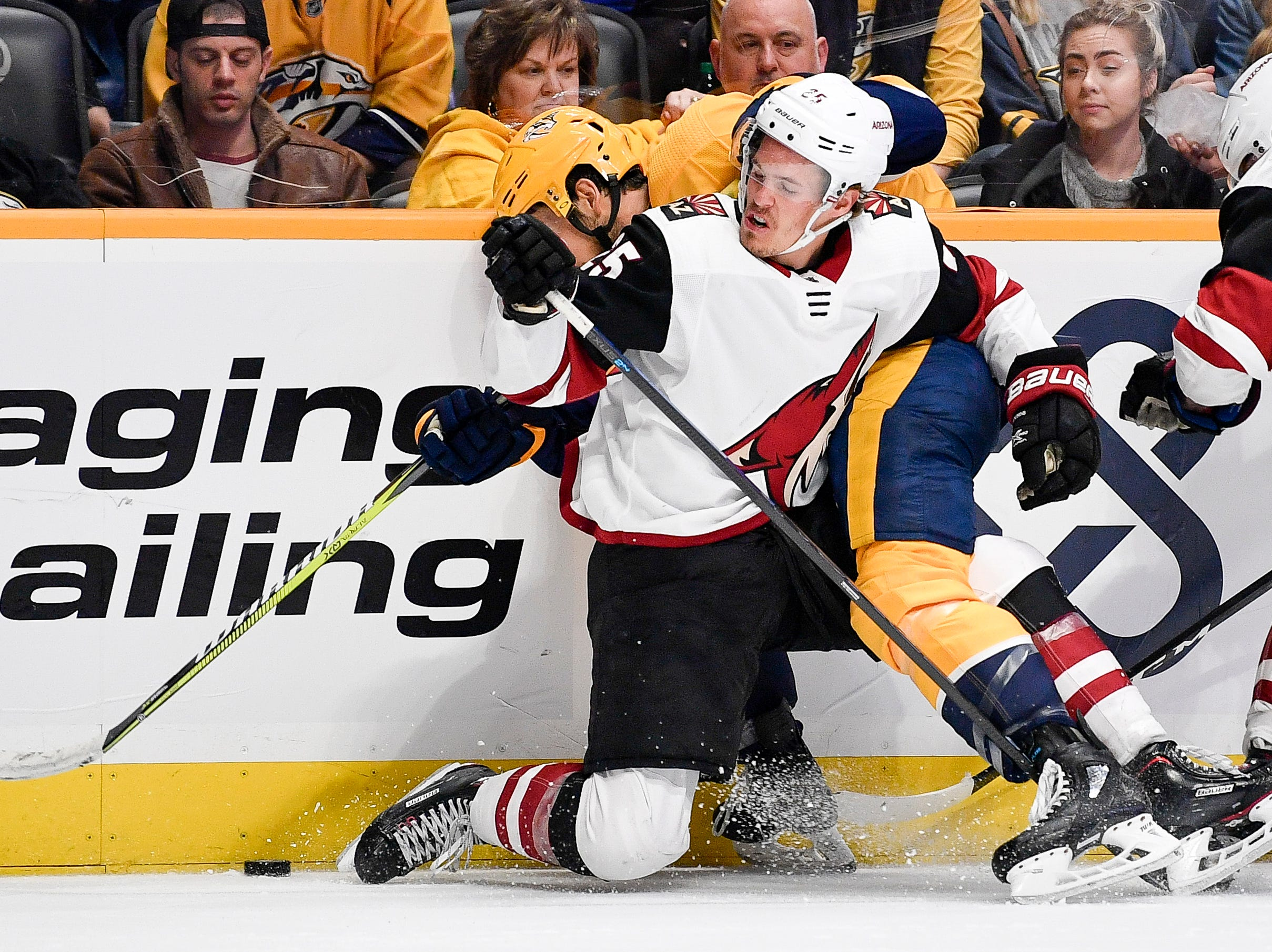 Arizona Coyotes center Nick Cousins (25) battles Nashville Predators center Frederick Gaudreau (89) during the third period at Bridgestone Arena in Nashville, Tenn., Tuesday, Feb. 5, 2019.