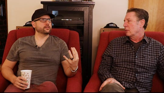 Chris DeStefano, left, talks to Bart Herbison about songwriting.