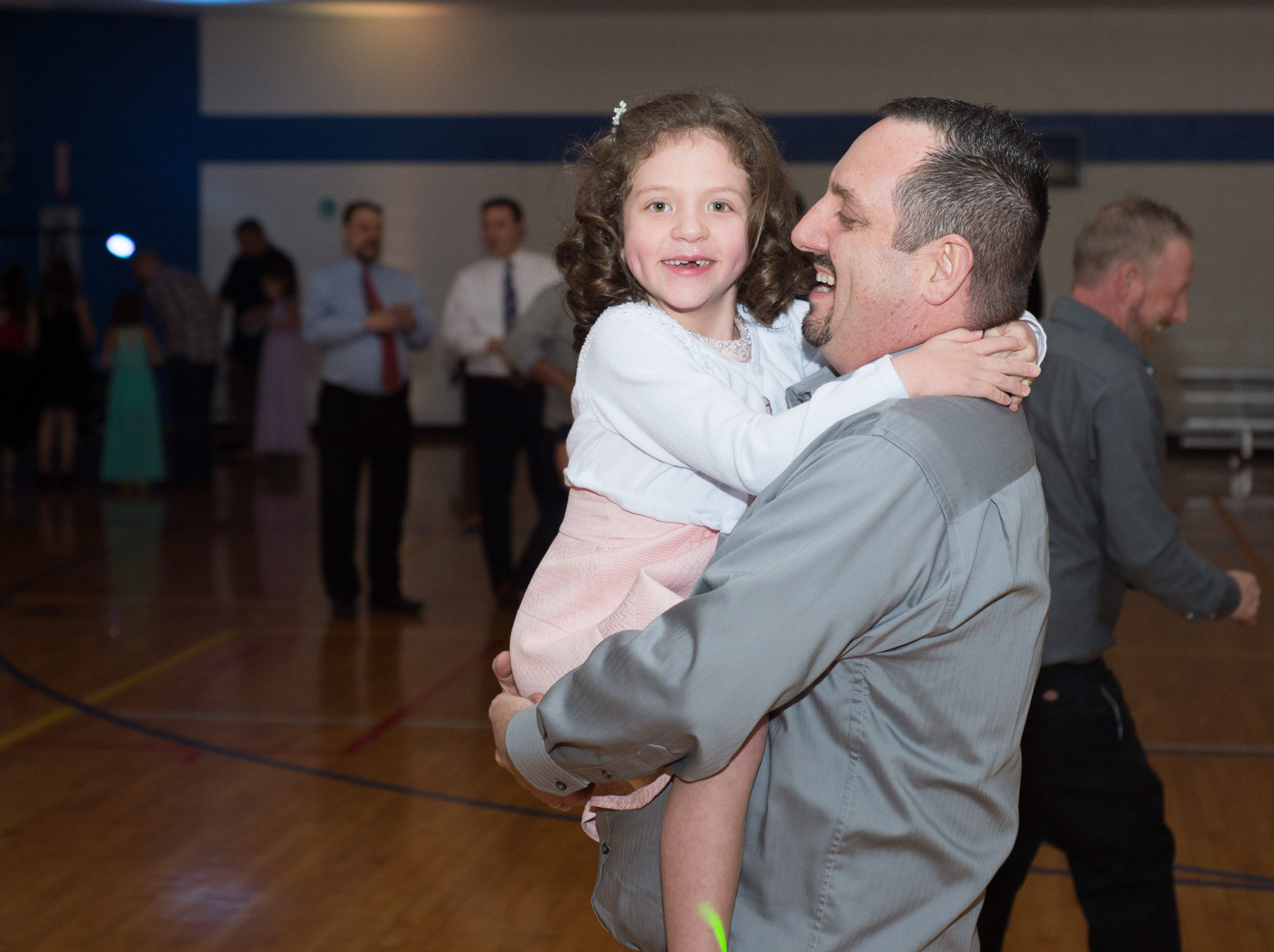 Attendees enjoy the Daddy Daughter Dance held at Delmas Long Community Center on Saturday, Feb. 2, 2019.