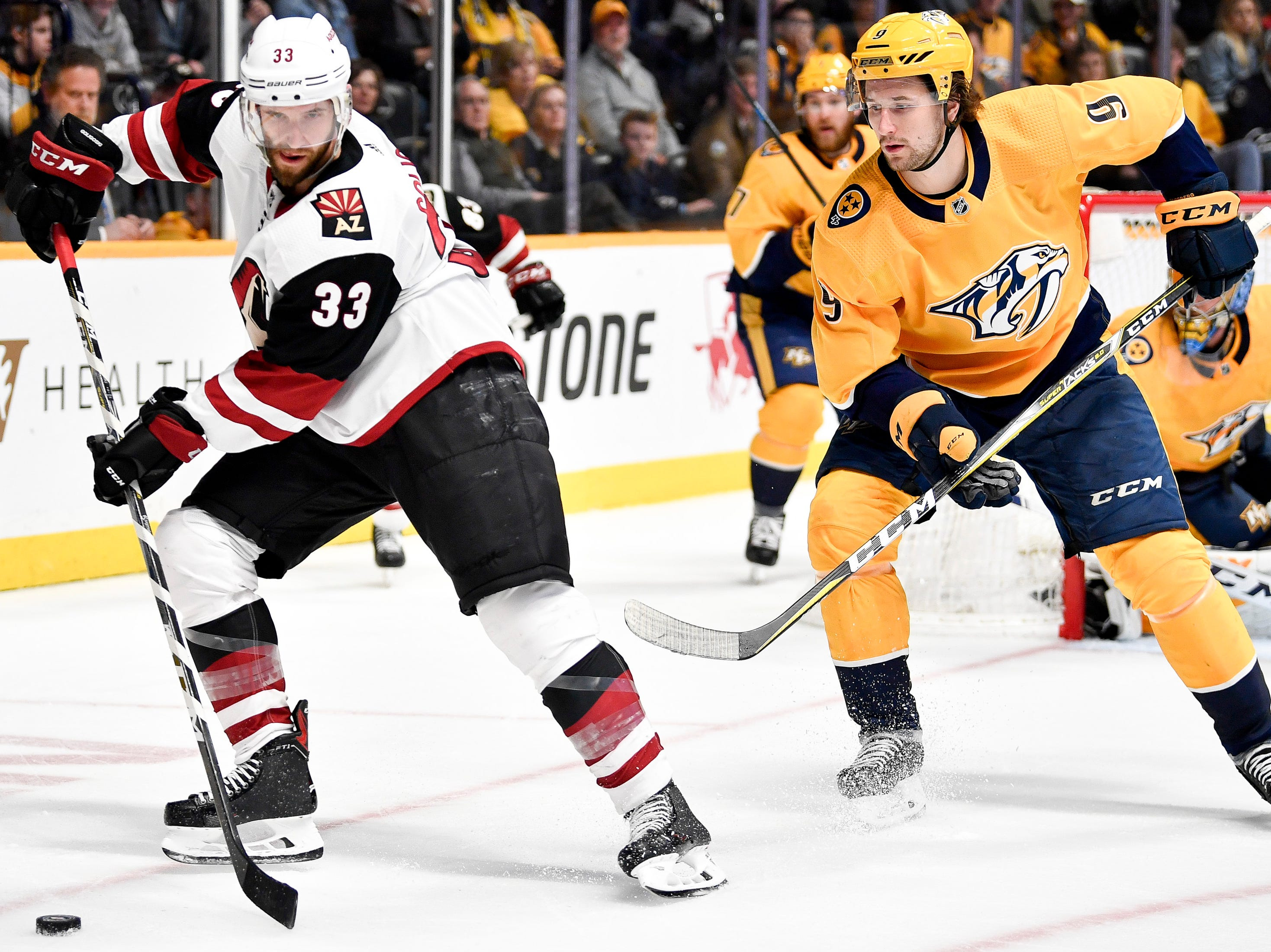 Arizona Coyotes defenseman Alex Goligoski (33) maneuvers around Nashville Predators left wing Filip Forsberg (9) during the second period at Bridgestone Arena in Nashville, Tenn., Tuesday, Feb. 5, 2019.