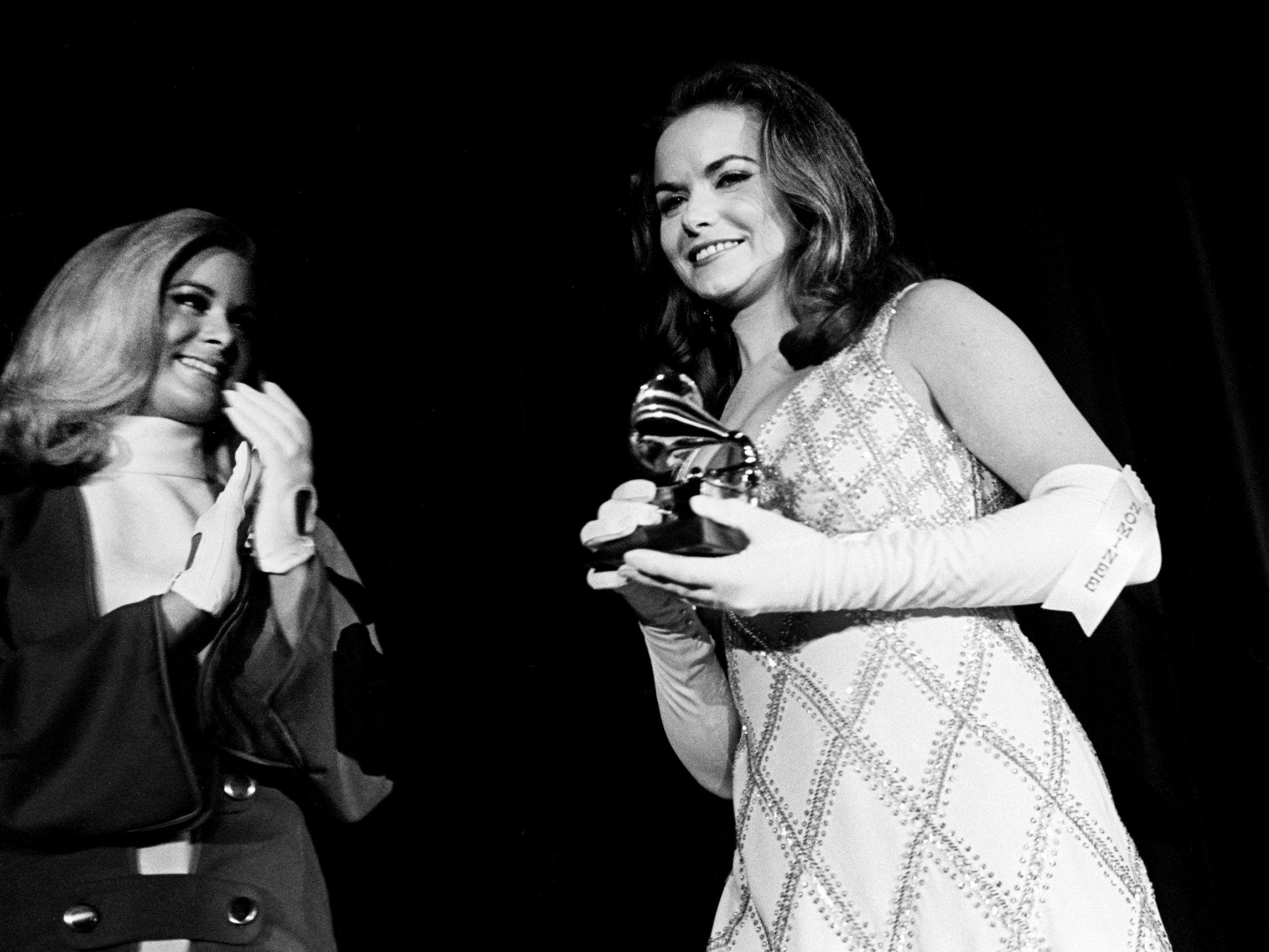 Jeannie C. Riley walks off stage with her Best Country Female Vocal Performance award during the 11th annual Grammy Award show at the National Guard Armory in Nashville March 12, 1969.