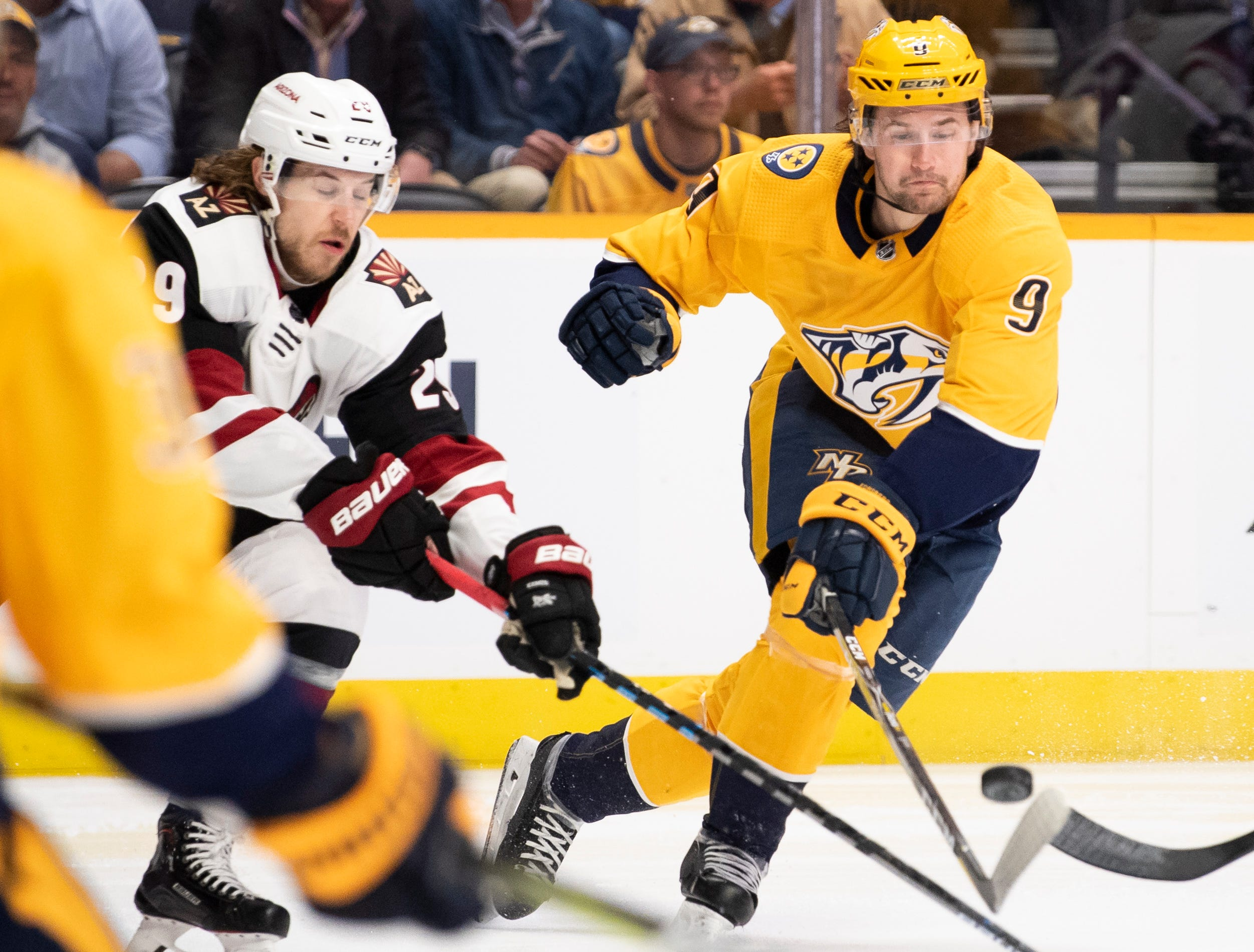 Nashville Predators left wing Filip Forsberg (9) passes past Arizona Coyotes right wing Mario Kempe (29) during the first period at Bridgestone Arena in Nashville, Tenn., Tuesday, Feb. 5, 2019.