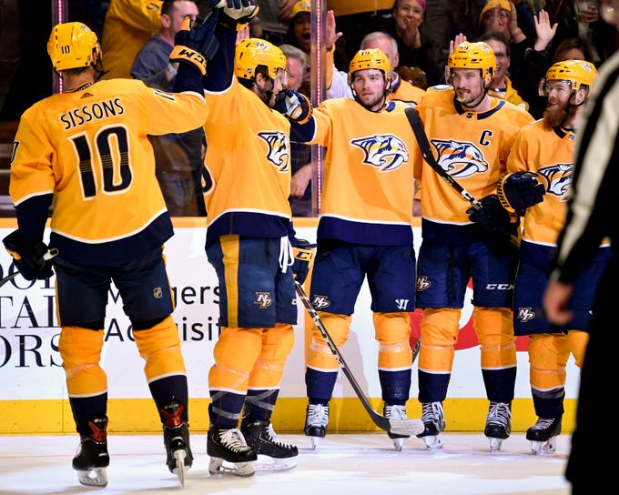 Nashville Predators center Calle Jarnkrok (19, center) celebrates with teammates after scoring against the Arizona Coyotes during the third period at Bridgestone Arena in Nashville, Tenn., Tuesday, Feb. 5, 2019.