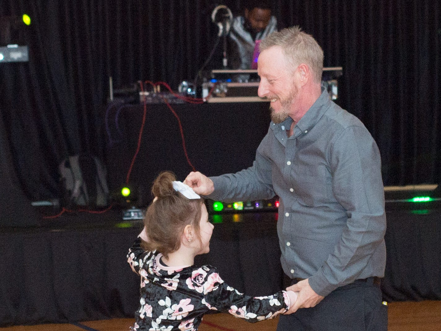 Attendees show off their best moves during the Daddy Daughter Dance held at Delmas Long Community Center on Saturday, Feb. 2, 2019.
