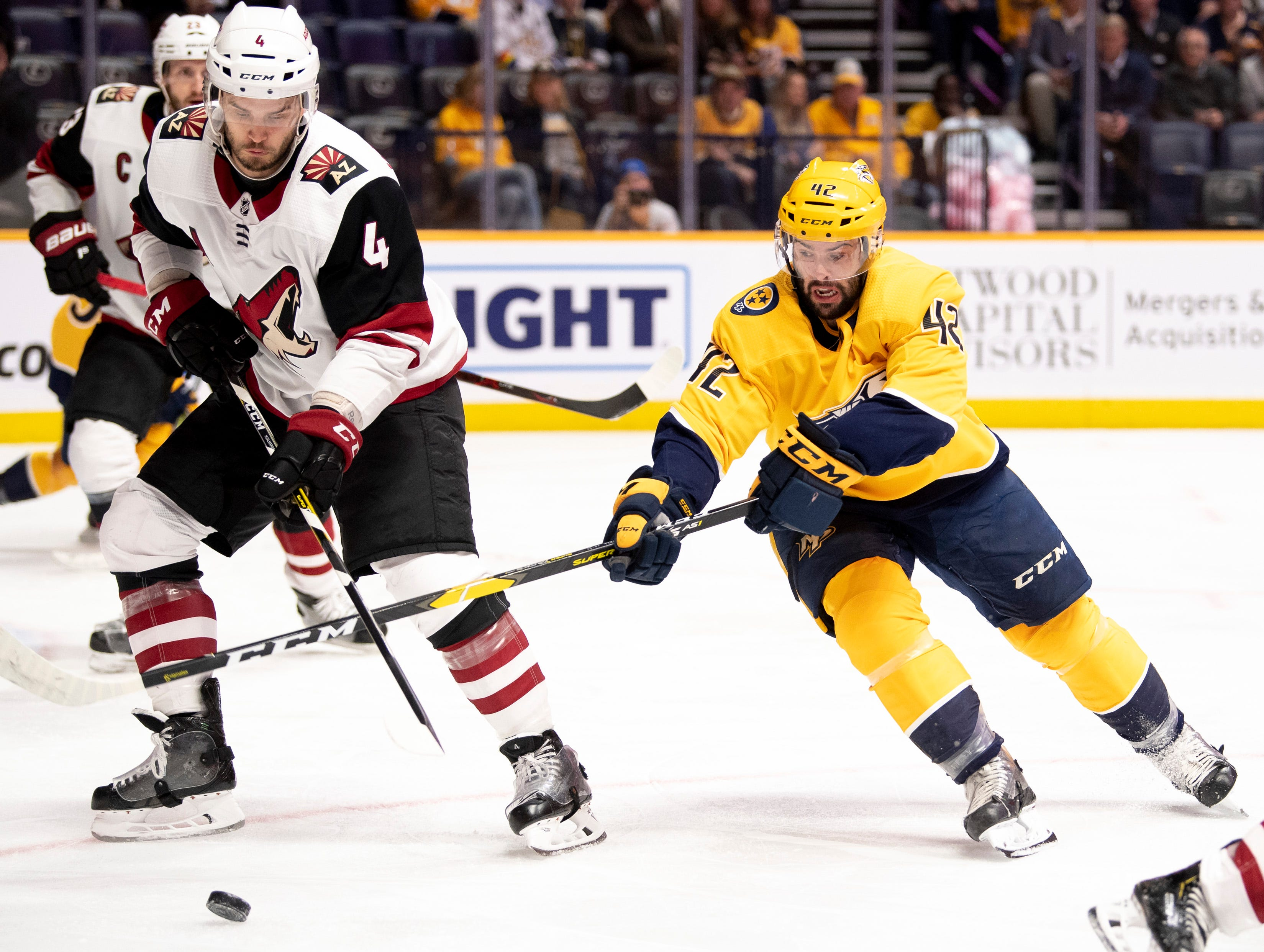 Nashville Predators center Colin Blackwell (42) fights for the puck with Arizona Coyotes defenseman Niklas Hjalmarsson (4) during the first period at Bridgestone Arena in Nashville, Tenn., Tuesday, Feb. 5, 2019.