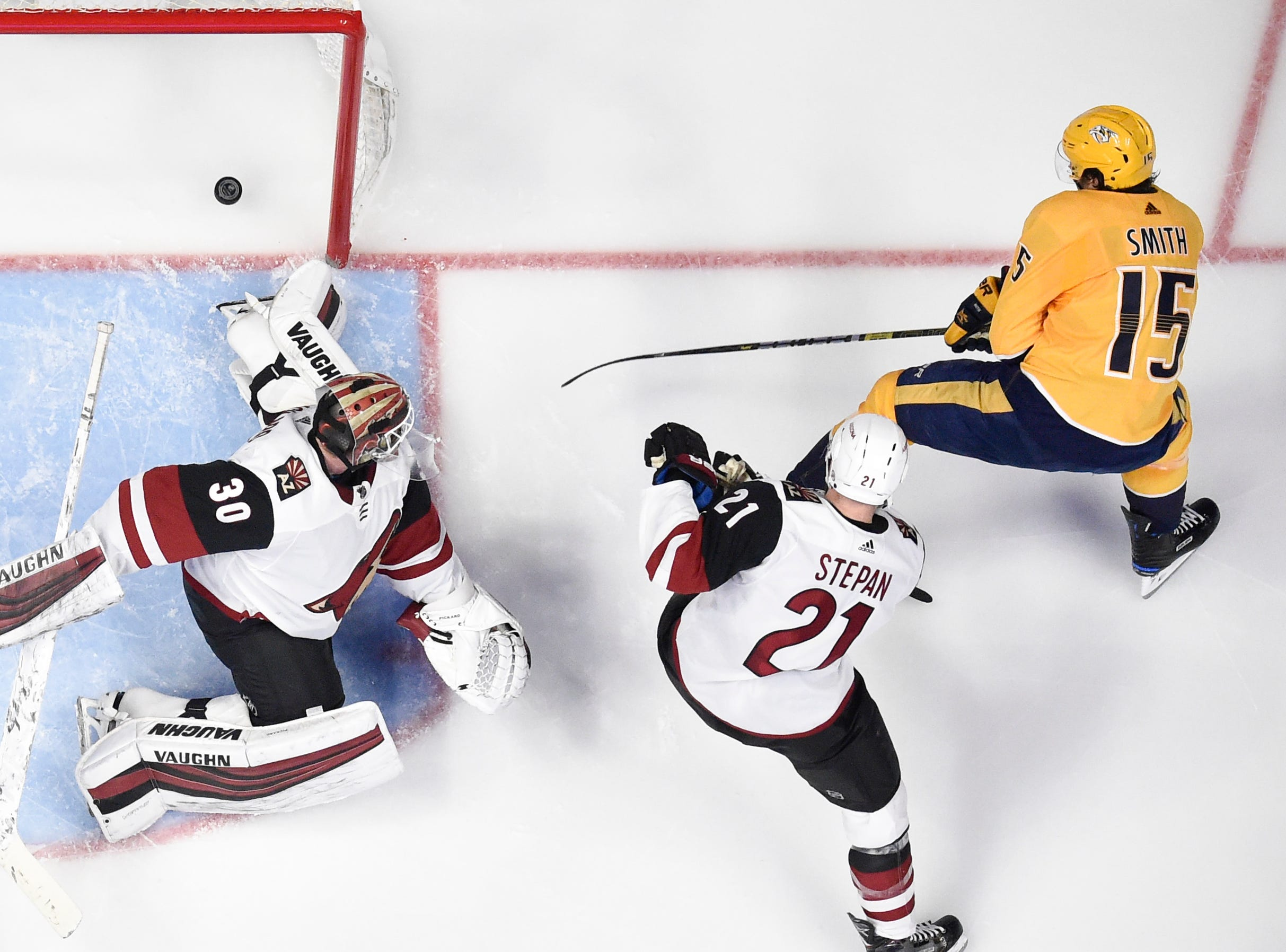 Nashville Predators right wing Craig Smith (15) scores past Arizona Coyotes goaltender Calvin Pickard (30) and center Derek Stepan (21) during the second period at Bridgestone Arena in Nashville, Tenn., Tuesday, Feb. 5, 2019.