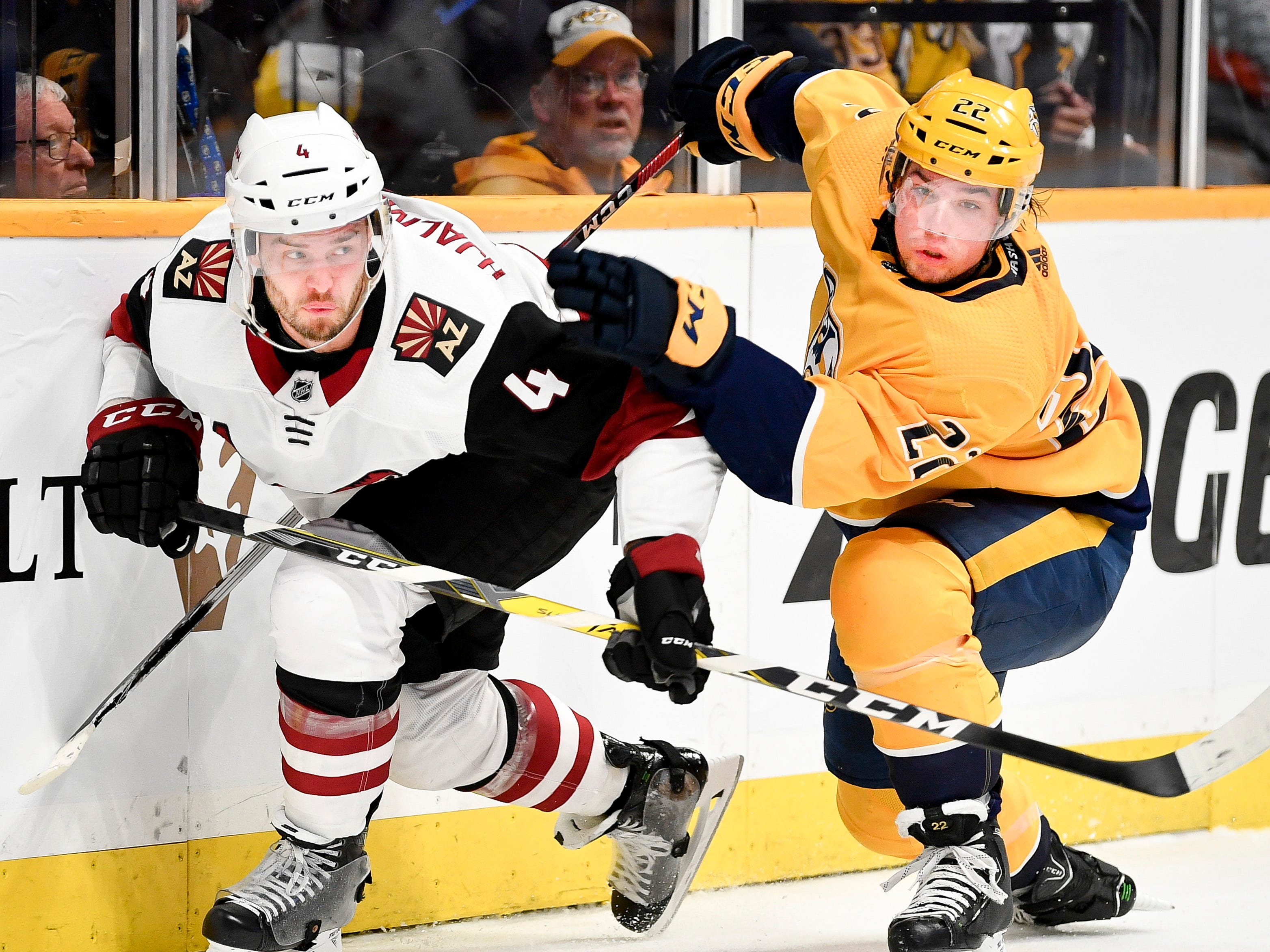 Arizona Coyotes defenseman Niklas Hjalmarsson (4) and Nashville Predators left wing Kevin Fiala (22) chase the puck during the first period at Bridgestone Arena in Nashville, Tenn., Tuesday, Feb. 5, 2019.