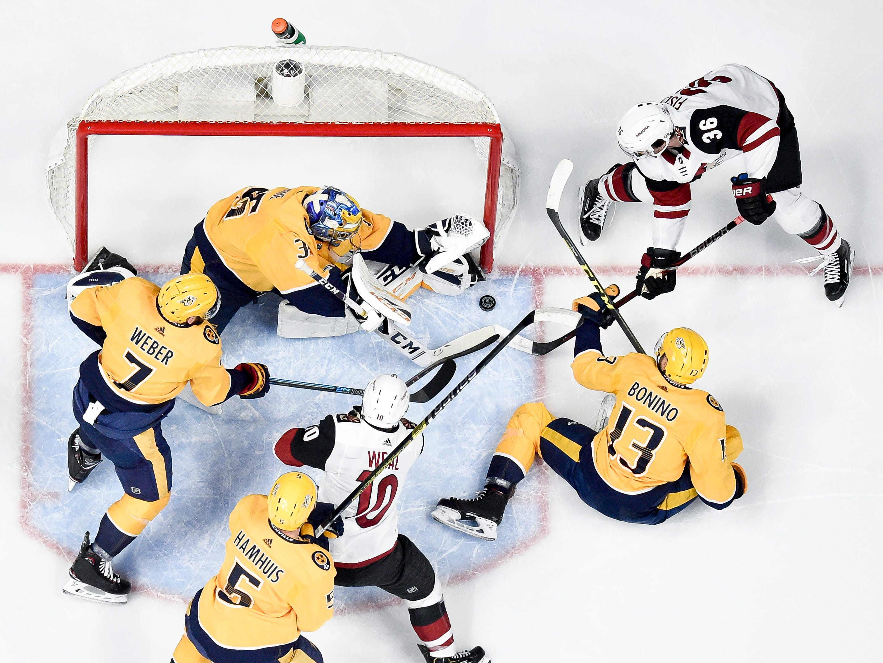 Nashville Predators goaltender Pekka Rinne (35) stops a shot from Arizona Coyotes right wing Christian Fischer (36) during the first period at Bridgestone Arena in Nashville, Tenn., Tuesday, Feb. 5, 2019.