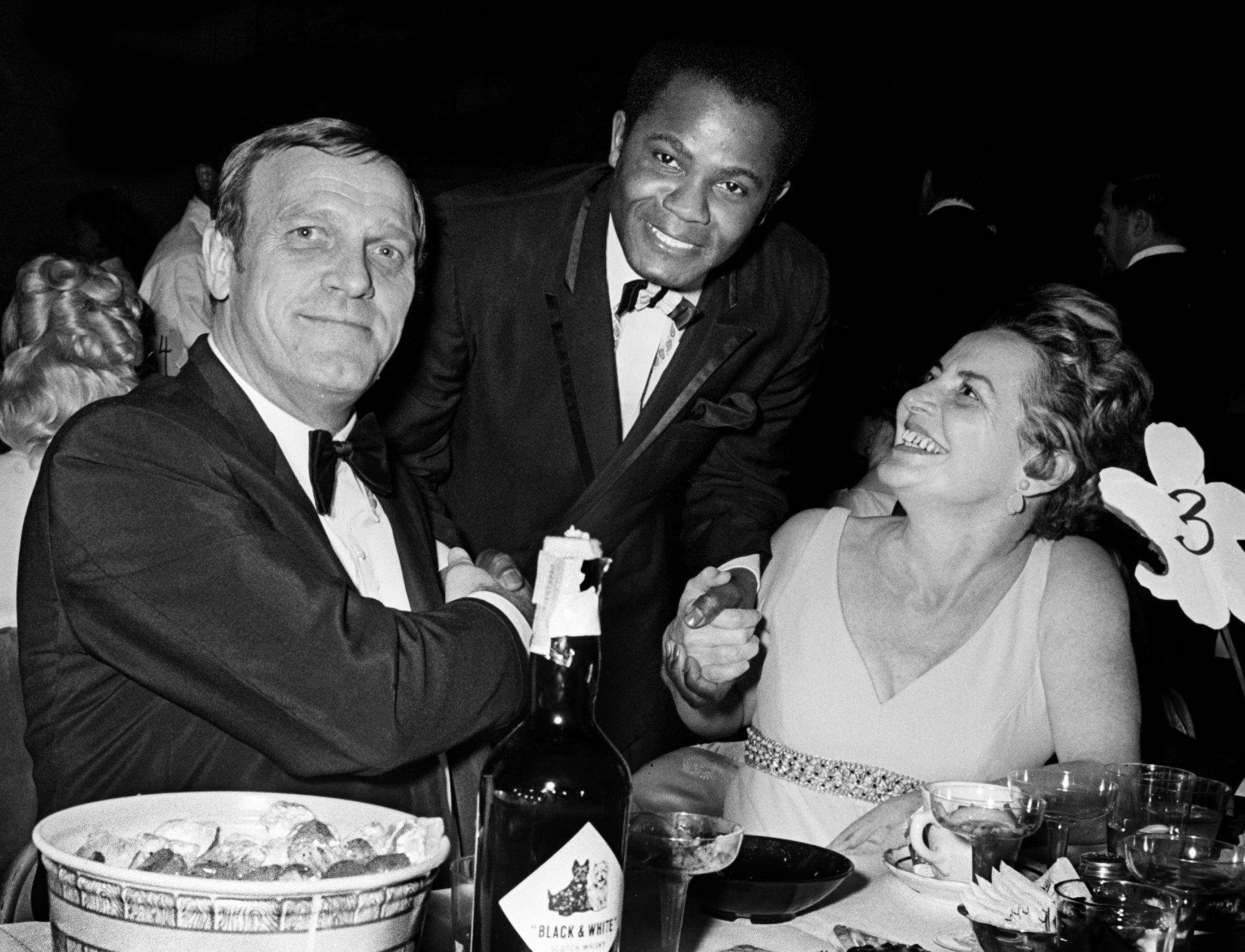 Eddy Arnold, left, and his wife Sally, right, greet another guest during the NARAS annual gala awards celebration for the Grammy at the National Guard Armory in Nashville March 12, 1969. Arnold presented one of the performers during the show.