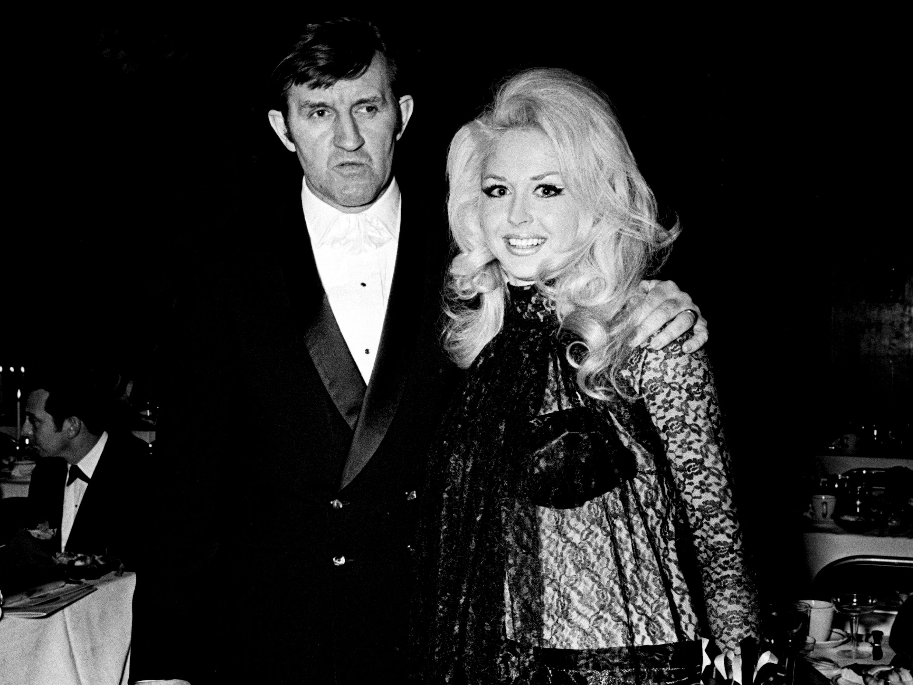 Not all the attraction were on stage, as songstress Demetriss Tapp, wore an eye-catching see-through harem costume. Escorted by her husband, songwriter Bob Tubert, they attended the NARAS annual gala awards celebration for the Grammy awards at the National Guard Armory March 12, 1969.