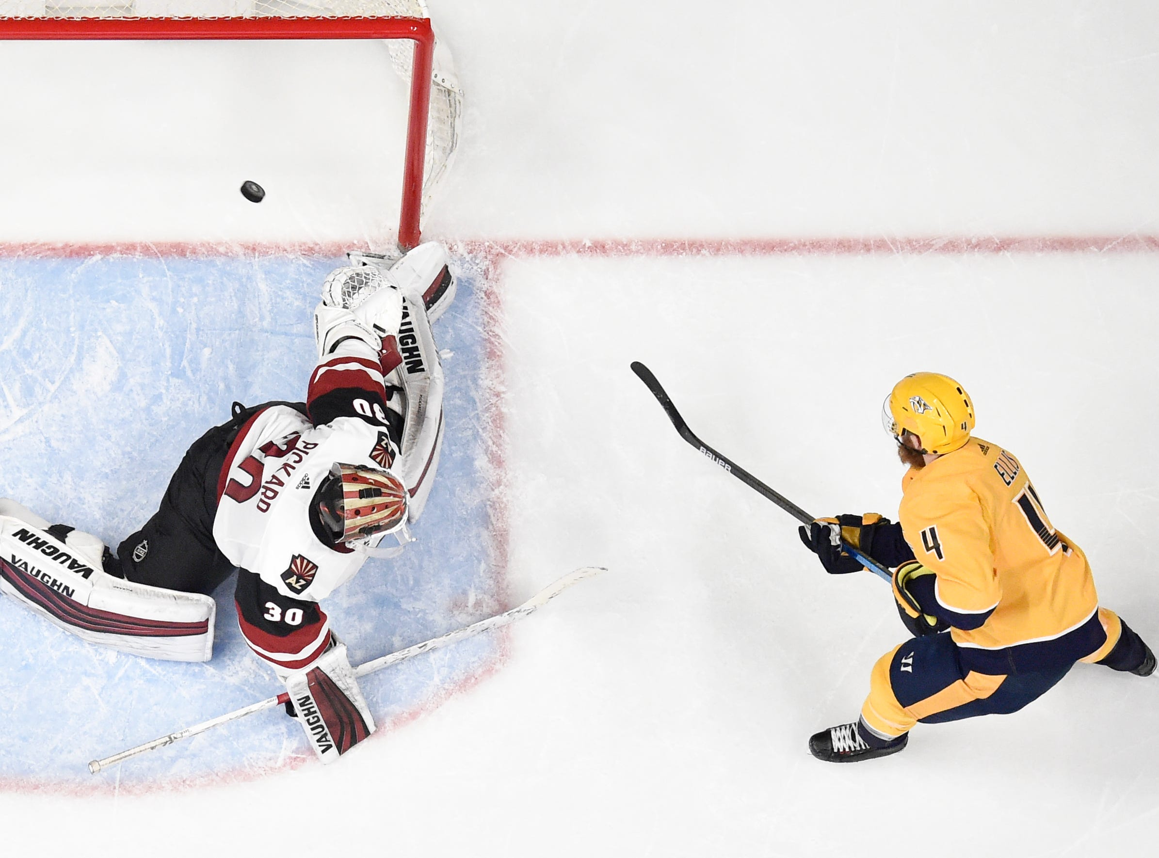 Nashville Predators defenseman Ryan Ellis (4) scores past Arizona Coyotes goaltender Calvin Pickard (30) during the second period at Bridgestone Arena in Nashville, Tenn., Tuesday, Feb. 5, 2019.