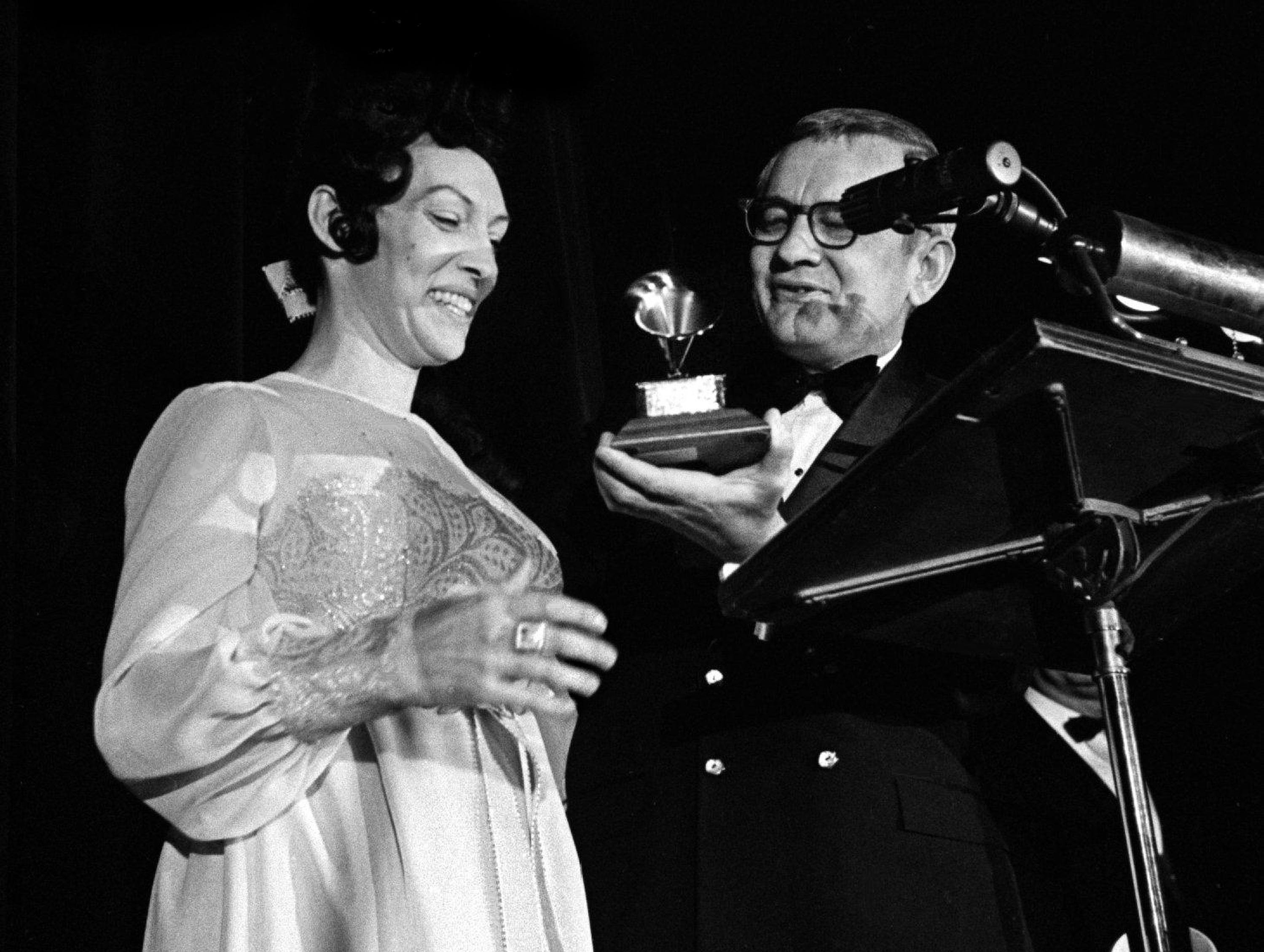 "Dottie Rambo, left, receivers her award for Best Soul Gospel Performance with ""The Soul of Me"" during the Grammy Award show at the National Guard Armory in Nashville March 13, 1969."