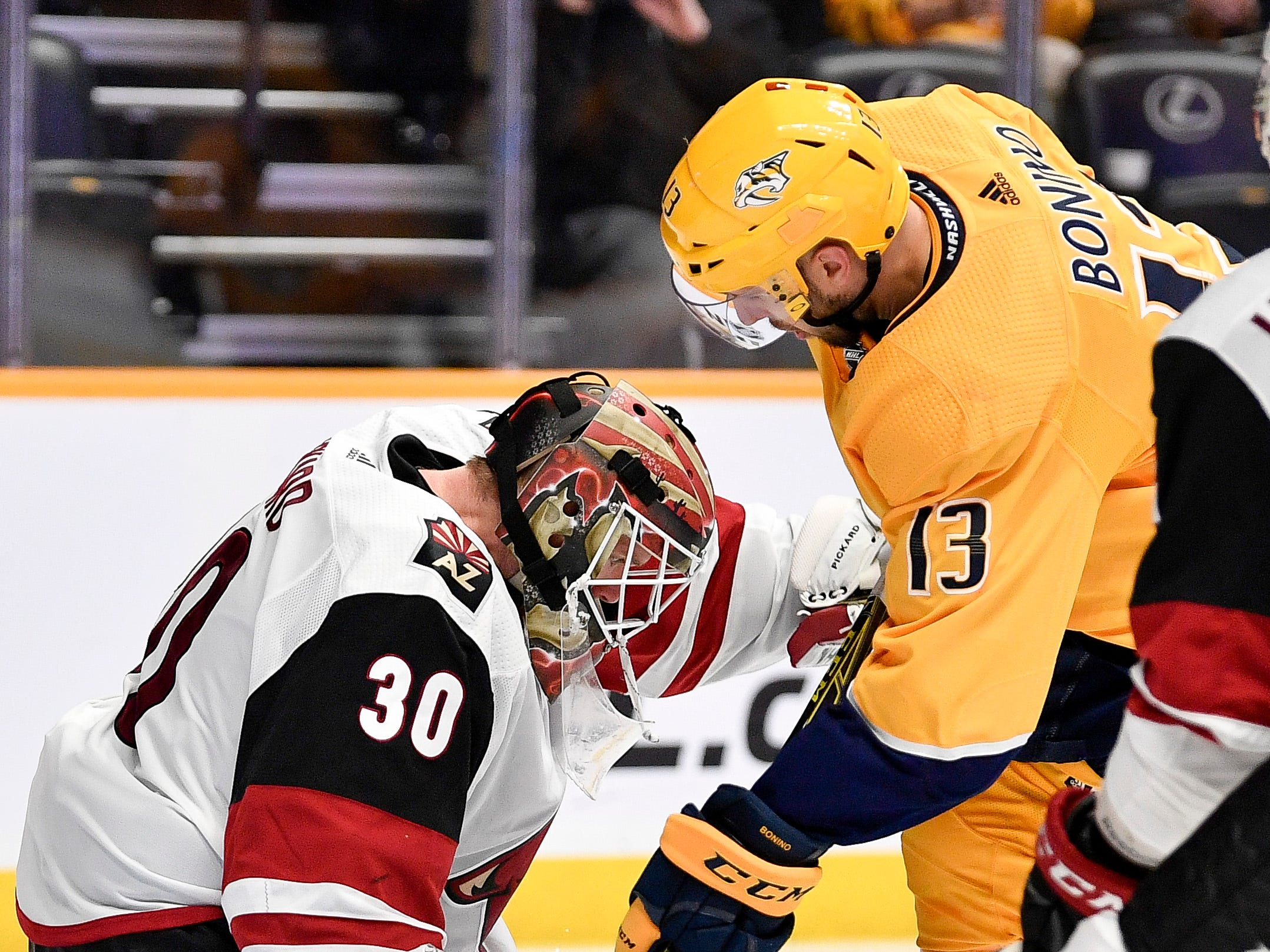 Arizona Coyotes goaltender Calvin Pickard (30) defends against Nashville Predators center Nick Bonino (13) during the third period at Bridgestone Arena in Nashville, Tenn., Tuesday, Feb. 5, 2019.