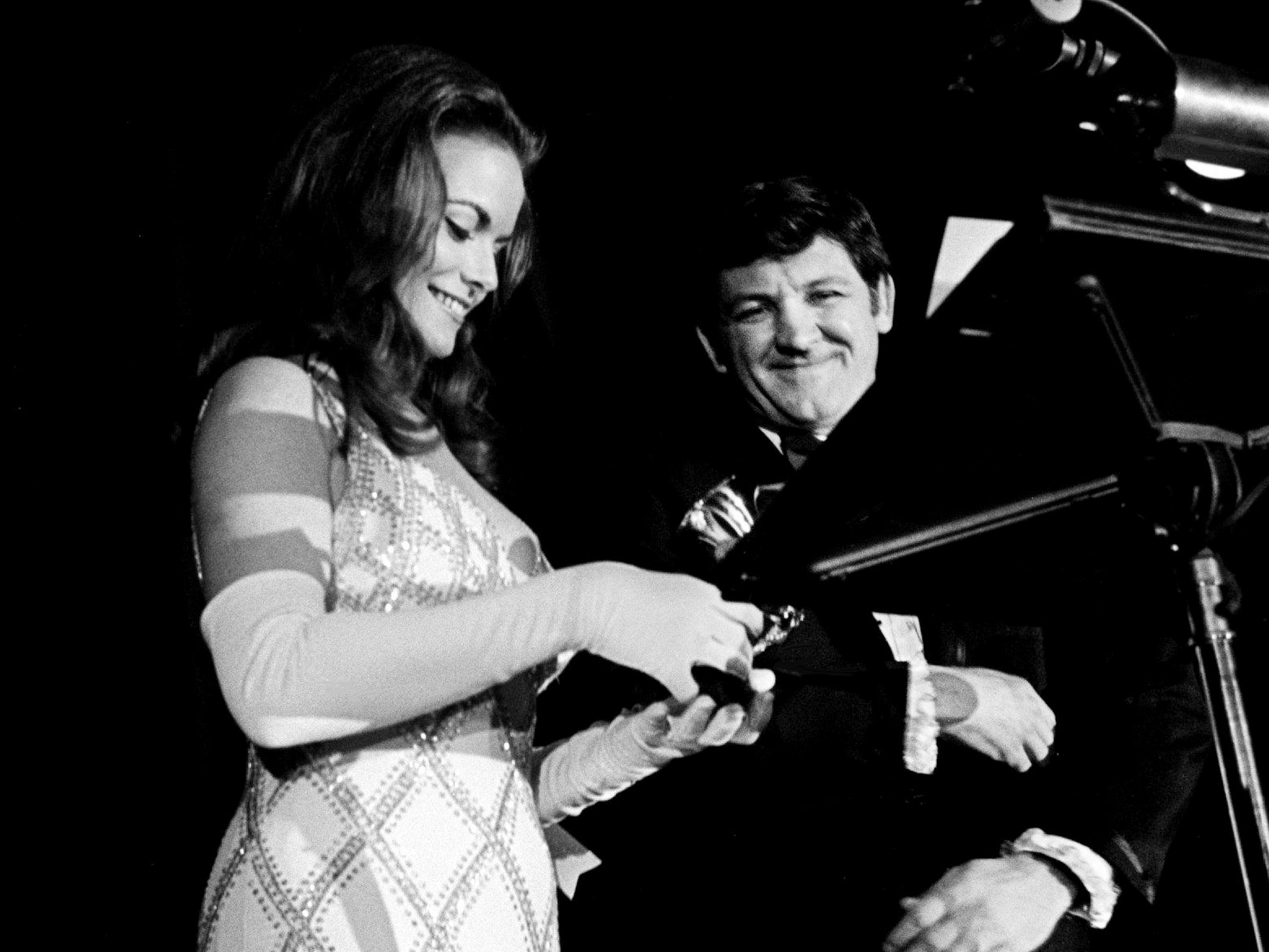 "Jeannie C. Riley, left, checks out her award for Best Country Female Vocal Performance as presenter George ""Goober"" Lindsey looks on during the 11th annual Grammy Award show at the National Guard Armory in Nashville March 12, 1969."